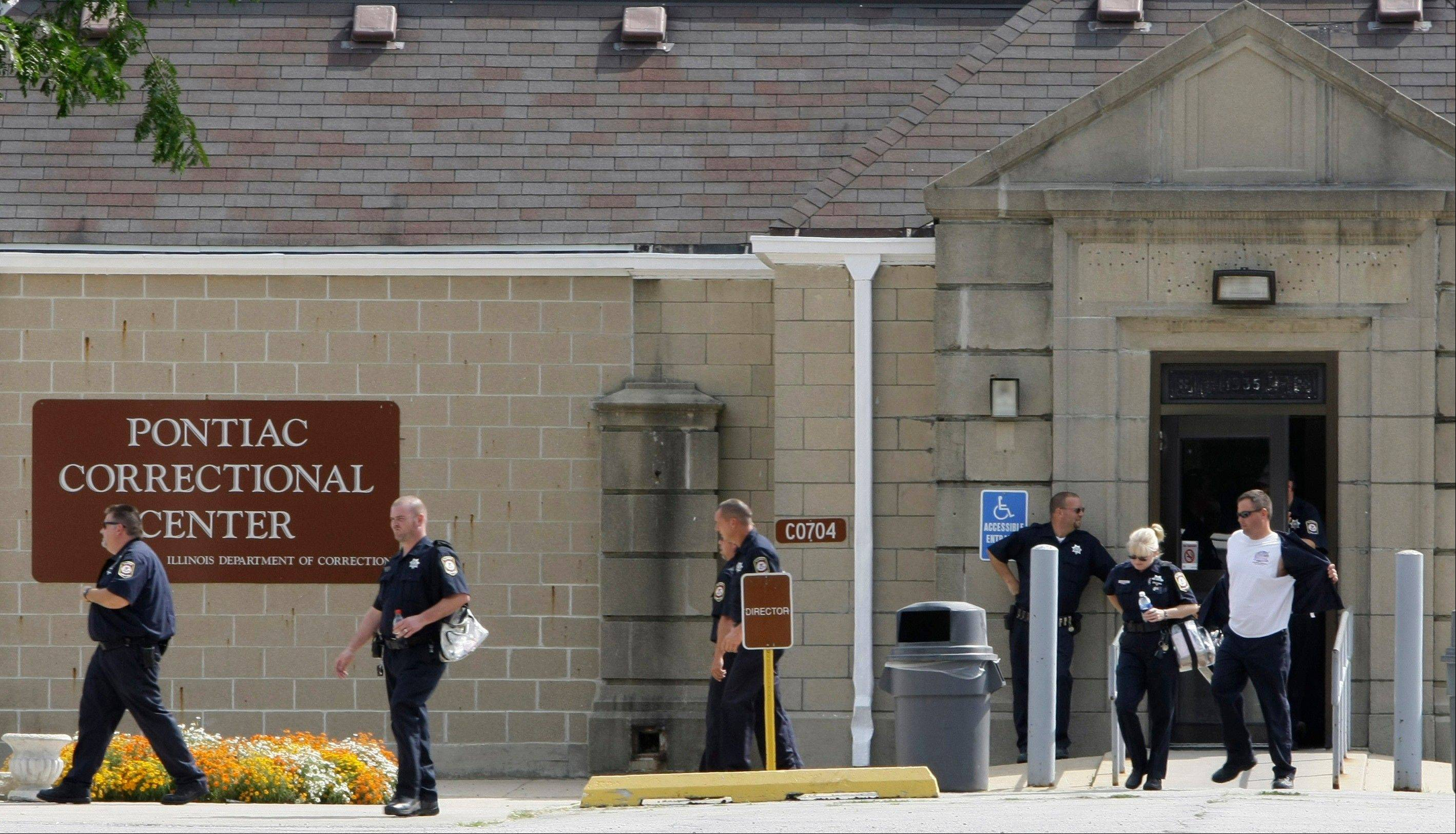 Corrections officers leave the downstate Pontiac Correctional Center during a shift change in 2008.
