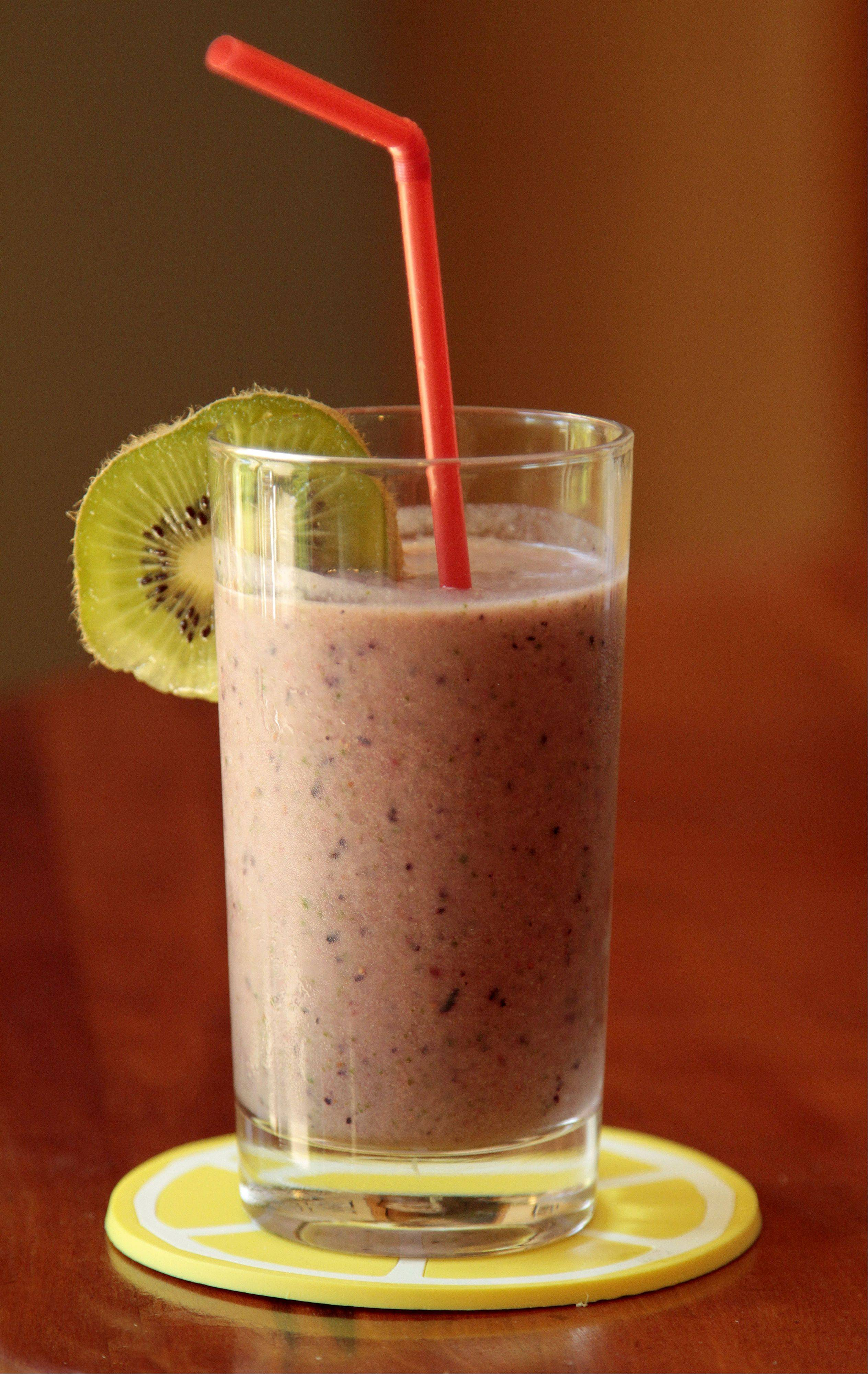 You don't need to stop at a convenient store for an energy boost. A homemade smoothie of blended blueberries, strawberries, kiwi, spinach, apple juice and milk gets you going.
