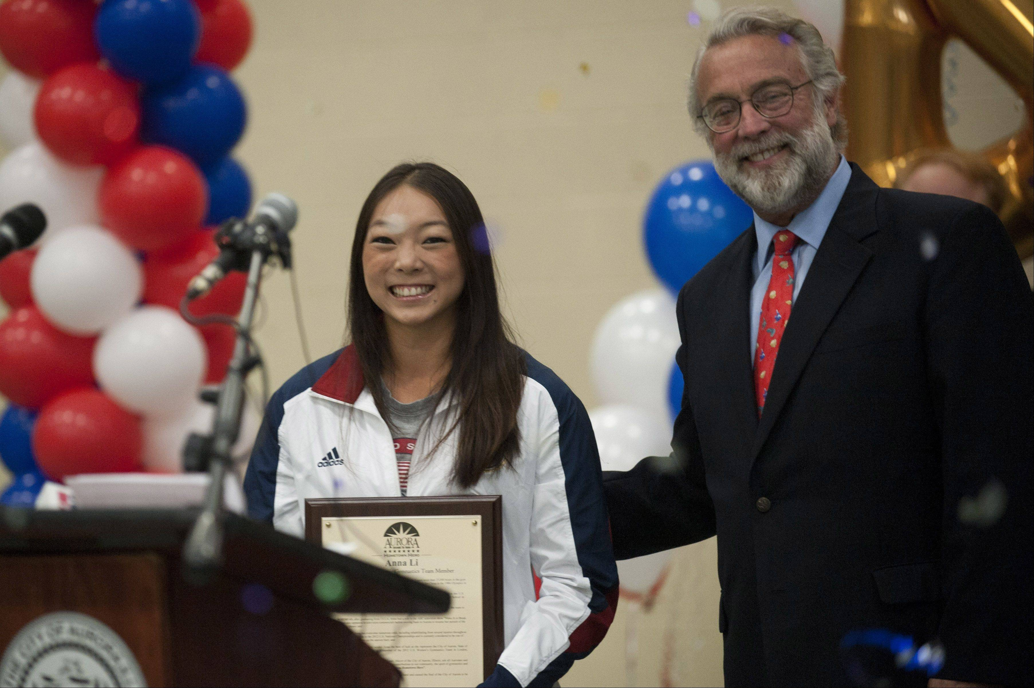 Anna Li, who was chosen last Sunday as an alternate member of the U.S. Women's Gymnastics team, was presented an award Monday by Mayor Tom Weisner during a send-off celebration in Aurora.