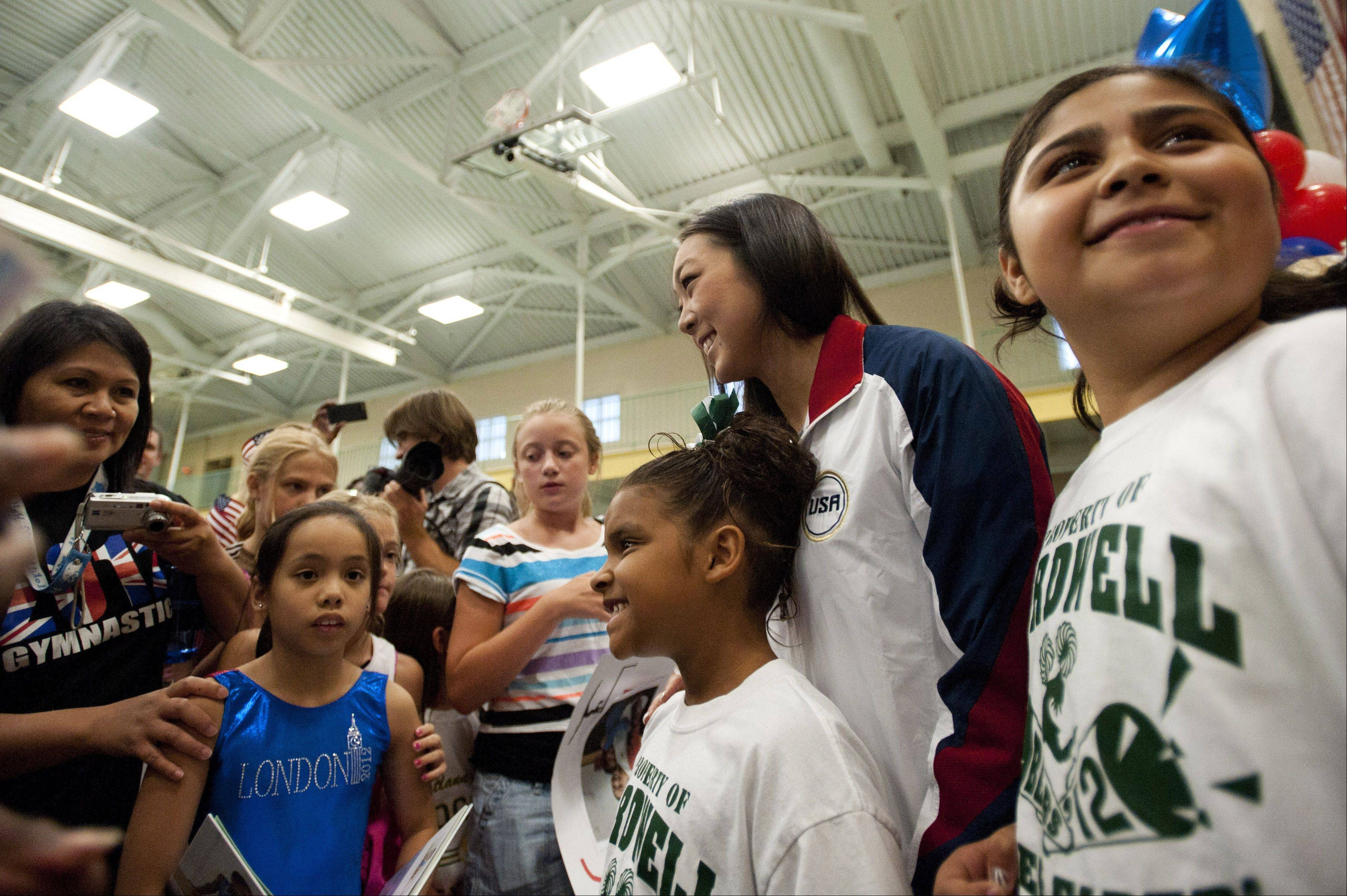 Fans mob Anna Li during a send-off celebration in Aurora on Monday. At 23, the Aurora native is one of few post-collegiate gymnasts to make it to the Olympics.