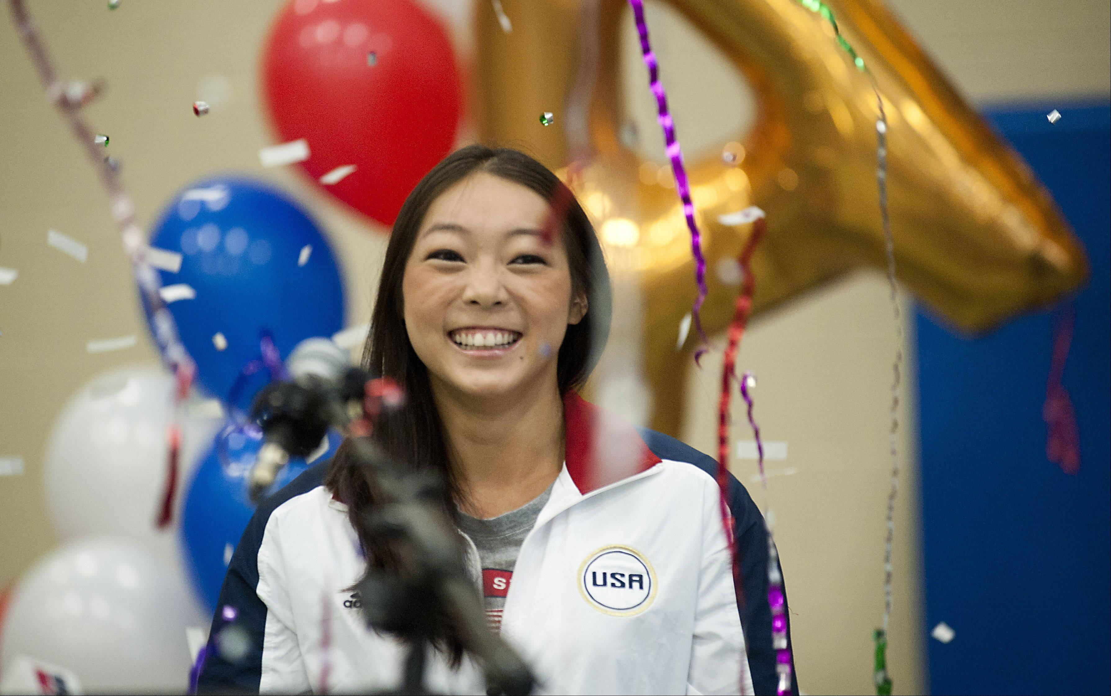 "Fans cheer and shower Anna Li with confetti in Aurora on Monday. ""It was amazing,"" Li said of seeing the crowd that gathered to wish her luck at the upcoming London Olympics."
