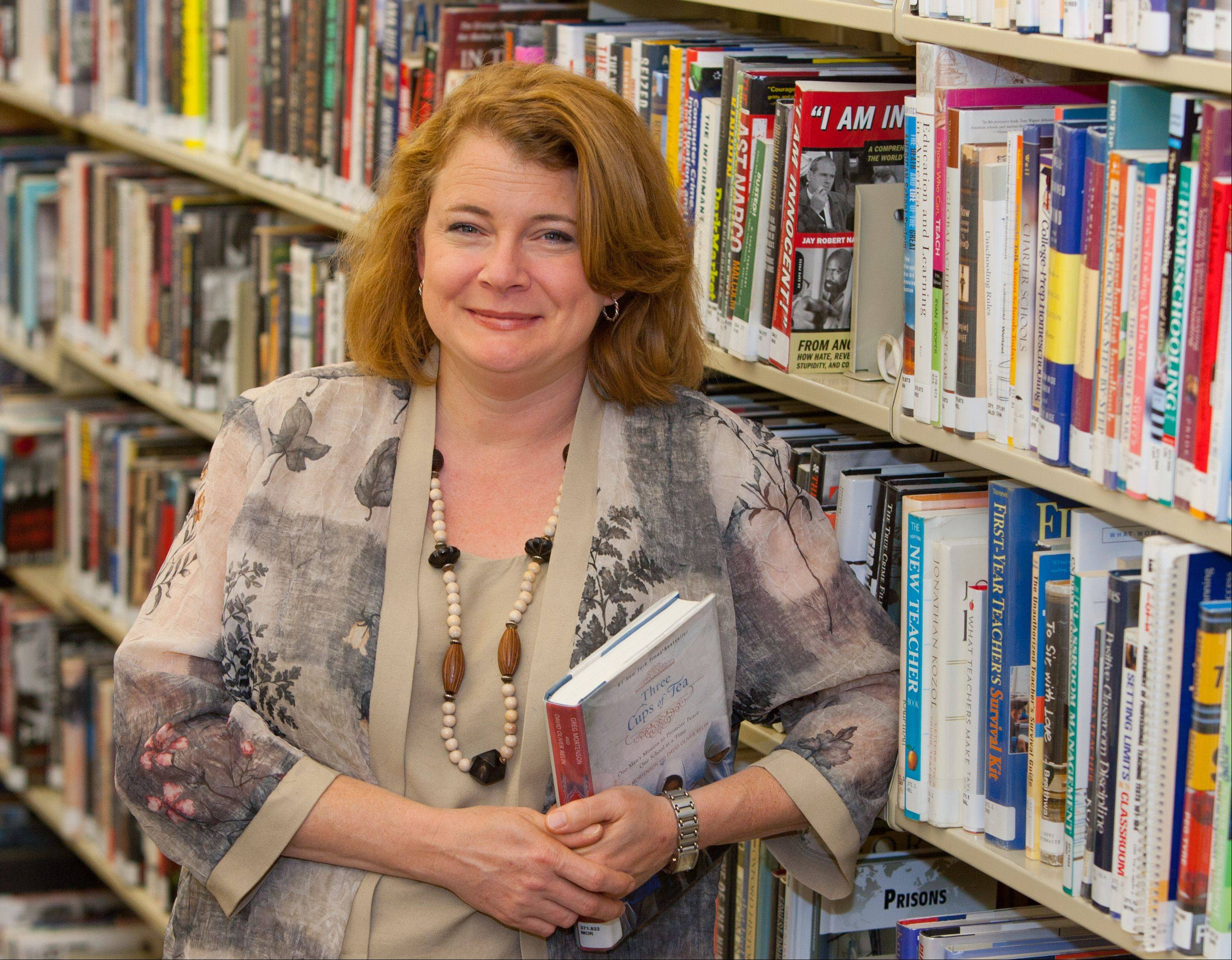 "Shannon Halikias, director of Lisle Public Library, says technology furthers the mission of public libraries to provide readers with information and service. ""Libraries constantly evolve, and, in fact, because we're willing to evolve, that's one of the reasons why we're a sustaining organization,"" she said."