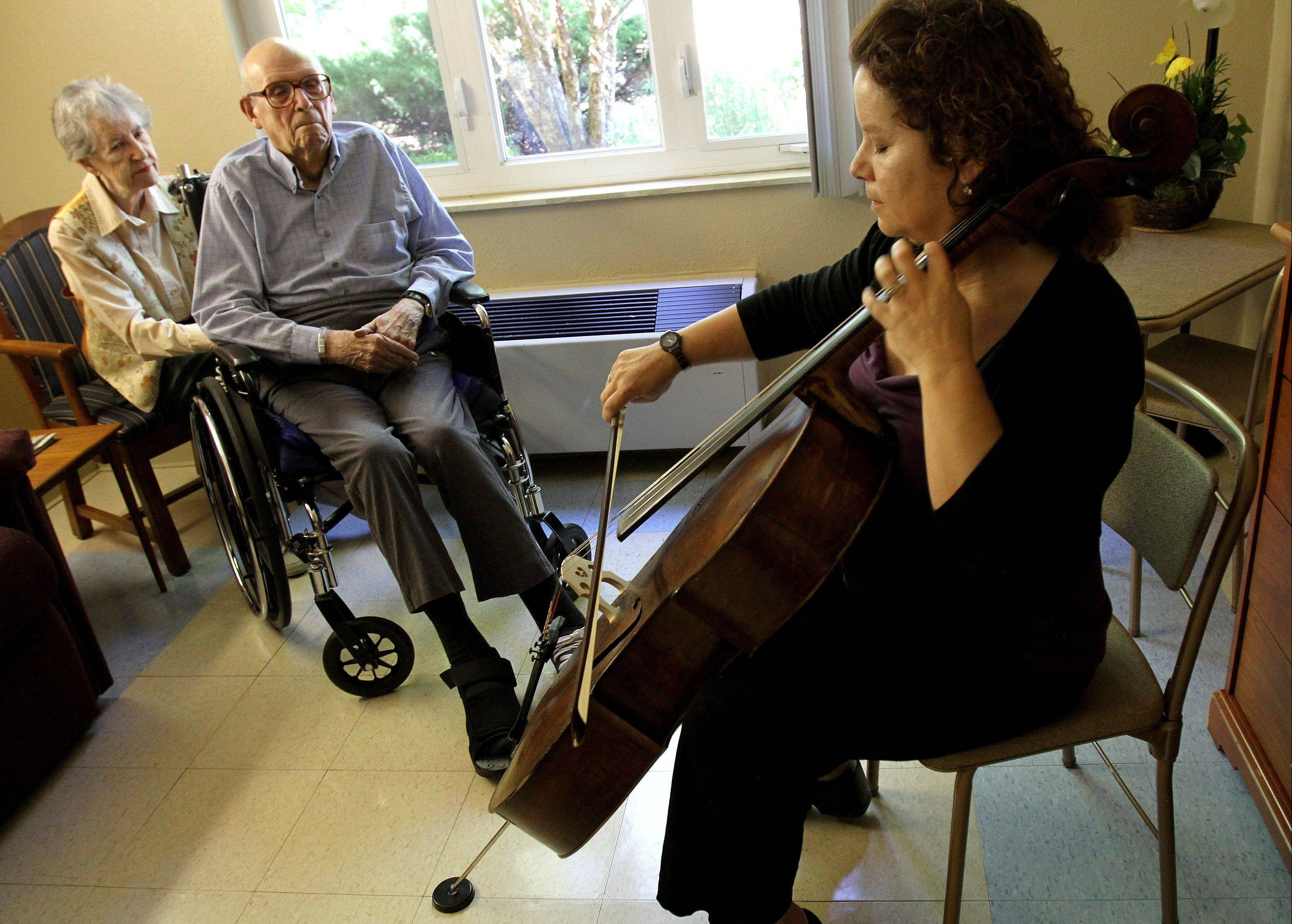 Cellist Pippa Downs of Wheaton performs once a month for residents at Wynscape Skilled Nursing and Rehabilitation in Wheaton. She also provides individual performances for those who don't get out of their rooms often, those suffering severe pain or anxiety, or those who may be terminally ill.