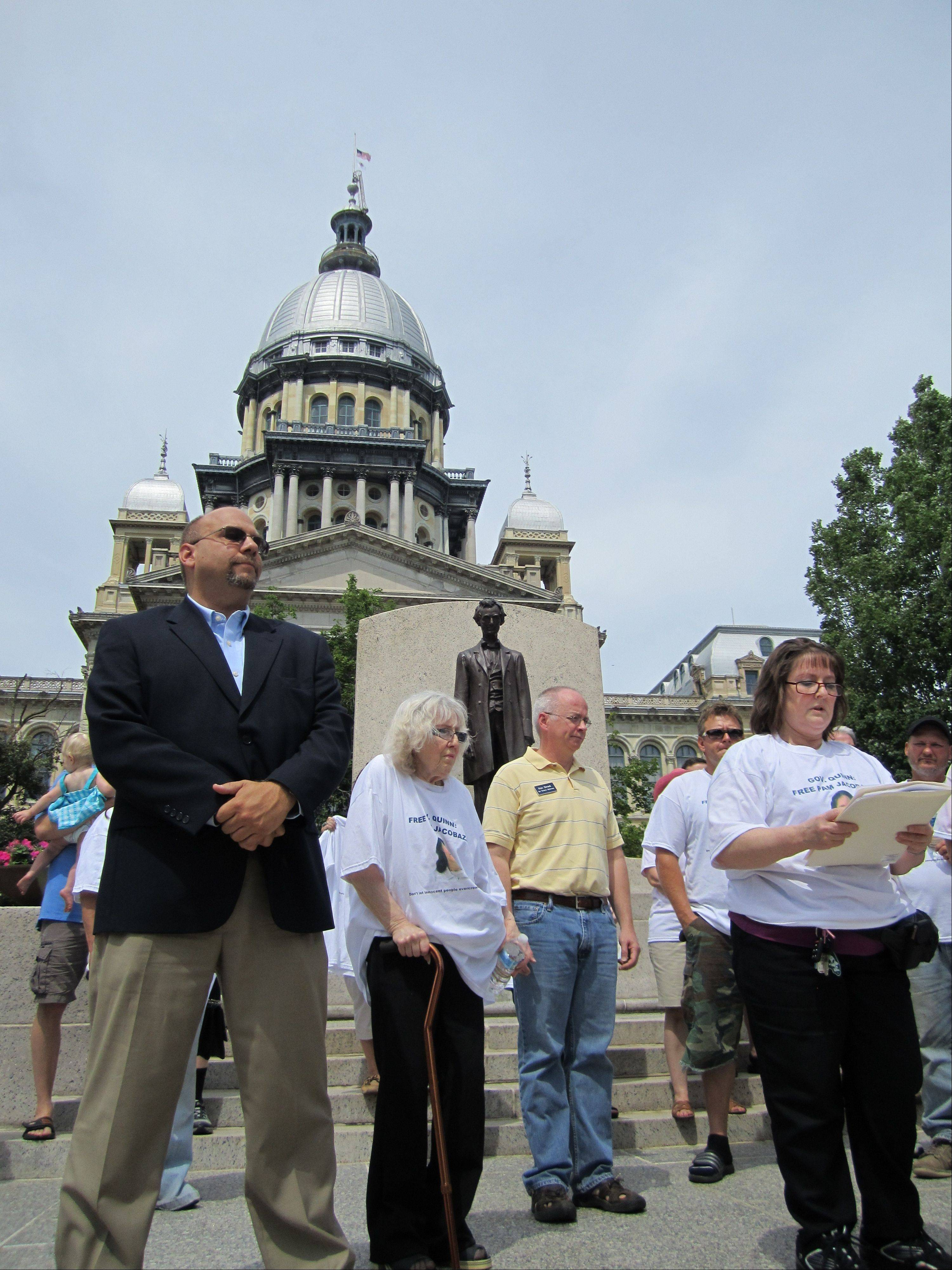 Supporters of Pamela Jacobazzi gather at the Illinois Capitol June 23 to ask Gov. Pat Quinn for clemency. Her sister, Vita Giessler, right, and attorney Anthony Sassan, left, helped lead the rally.