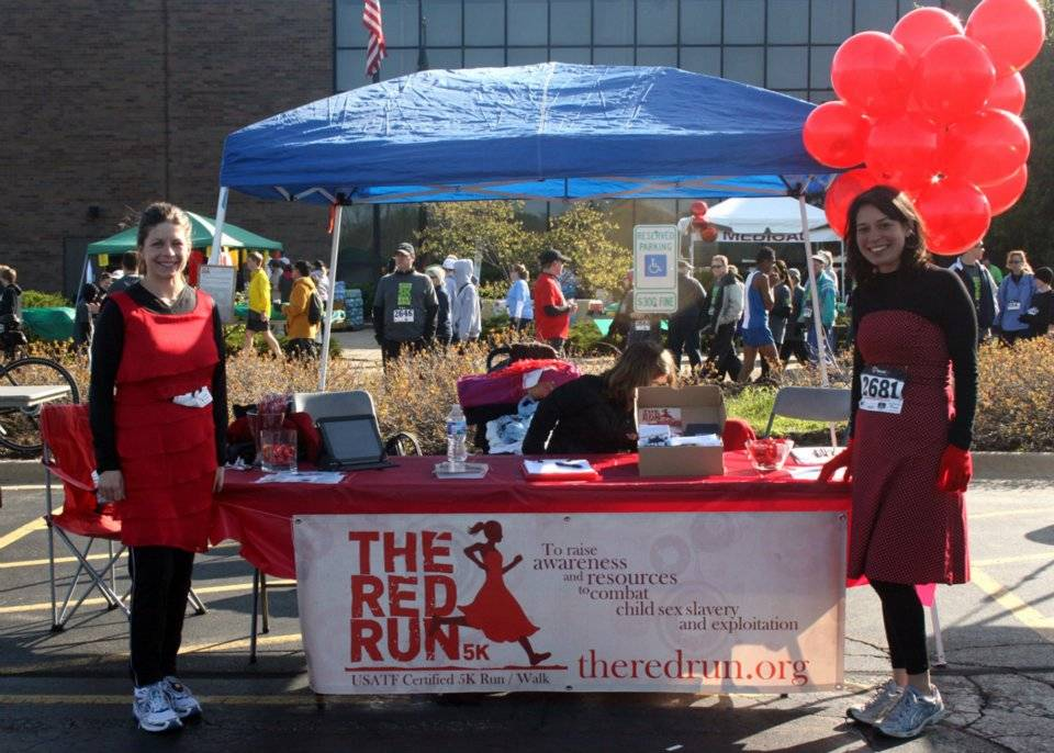 Local moms, Kristen Guerrieri (left) and Cortina Nystad (right) promoting their race, The Red Run, which aims to raise awareness and resources to end child sex trafficking in Illinois and beyond.