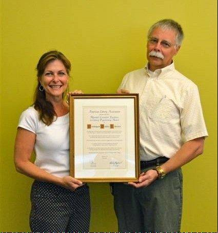 Elizabeth Stearns, assistant director of community services at the Waukegan Public Library, and Richard Lee, executive director, accepted the American Library Association's 2012 Marshall Cavendish Award for excellence in library programming.