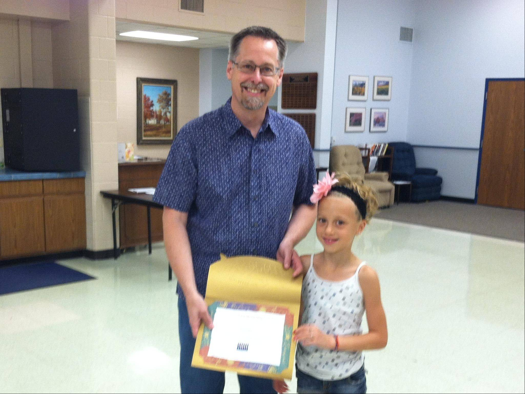 Character Coalition president Curt Hansen presents Izzy Ruiz with the Youth Service Award on July 3.