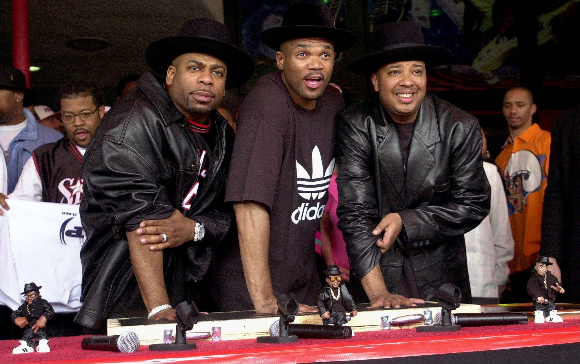 "It was announced Tuesday that Darryl ""DMC"" McDaniels, center, and Joseph ""DJ Run"" Simmons, the surviving members of Run-DMC, will reunite at the Fun Fun Fun Fest in Austin, Texas on Nov. 2-4. Simmons retired from the group after Jason ""Jam Master Jay"" Mizell, left, was shot to death in 2002."