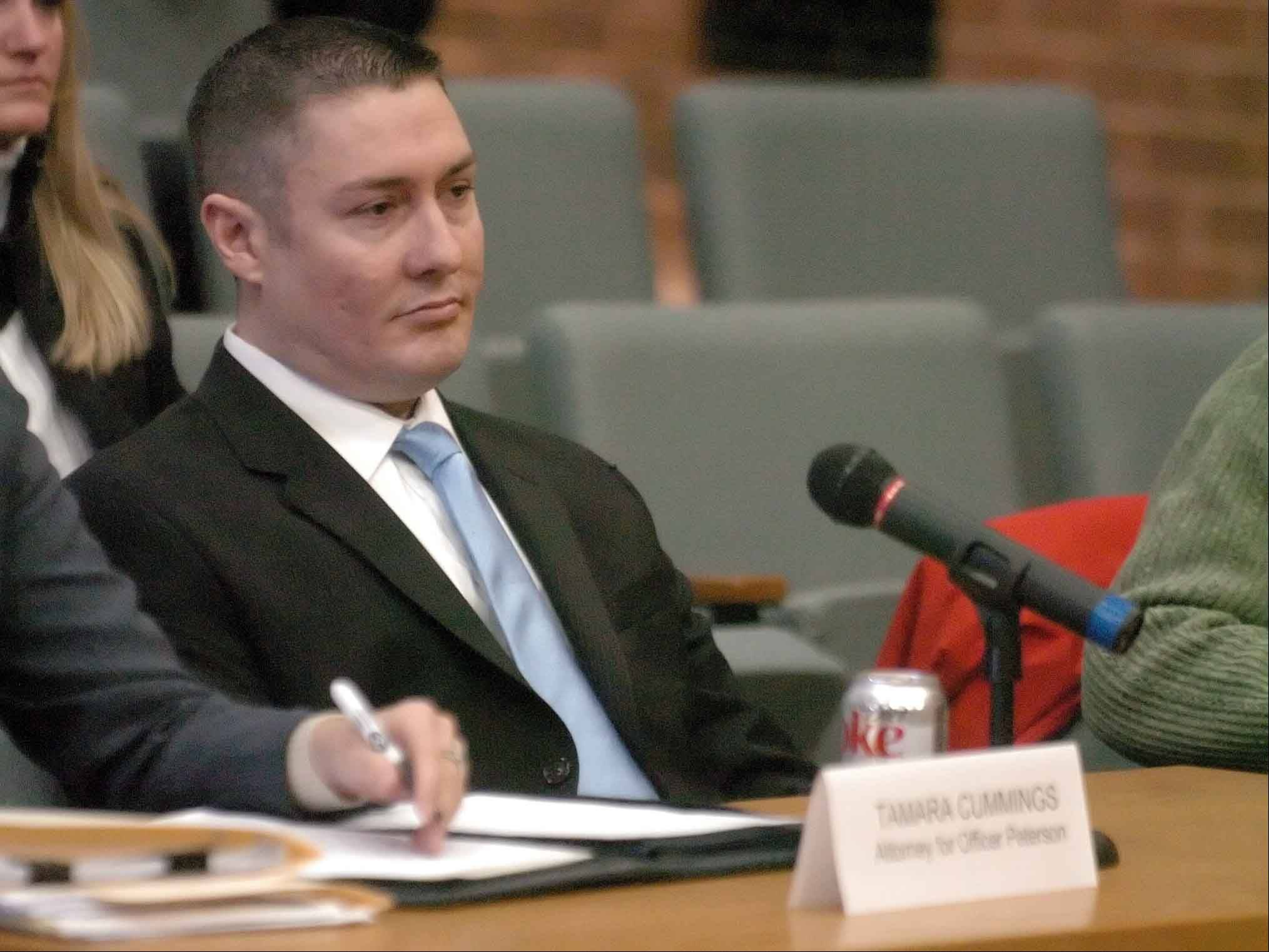PAUL MICHNA/Daily Herald file photo Former Oak Brook Police Officer Stephen Peterson attends an administrative hearing, which ultimately resulted in him losing his job in February 2011. Peterson sued the village and its former police chief Tuesday, claiming there was a conspiracy to ouster him.