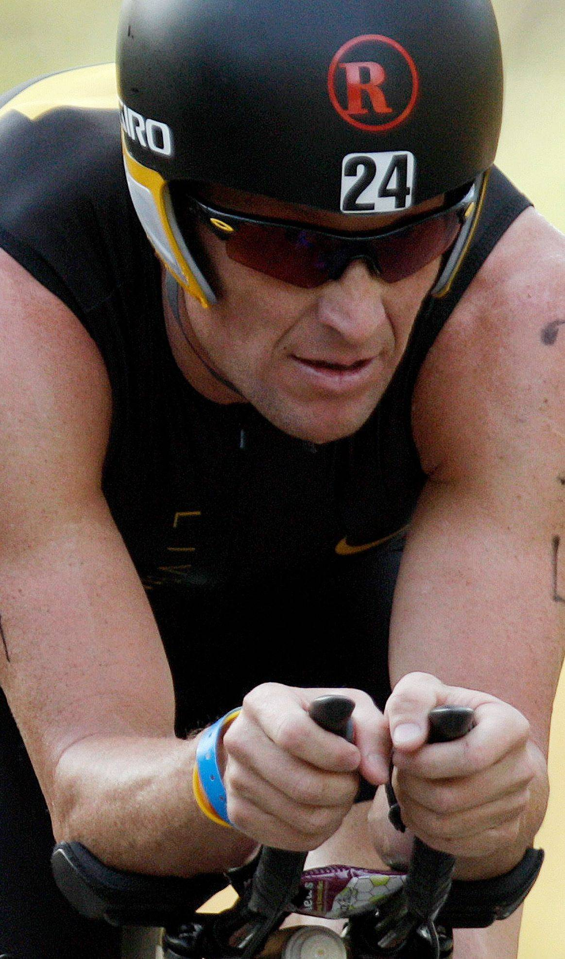 In this file photo, Lance Armstrong competes in this year's Ironman Panama 70.3. triathlon in Panama City, Panama. The seven-time Tour de France winner Monday filed a lawsuit in Austin, Texas, arguing the U.S. Anti-Doping Agency violates the constitutional rights of athletes when it brings charges against them.
