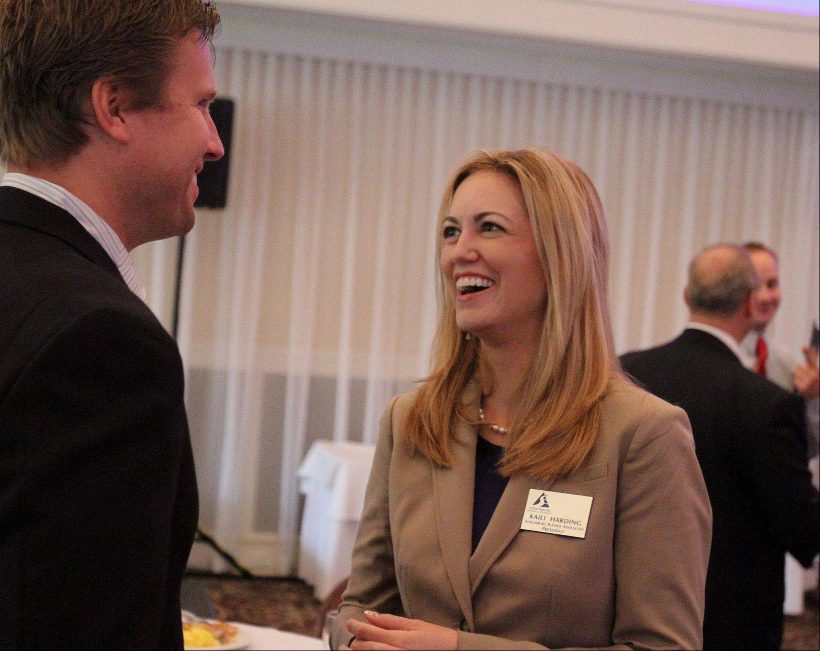 New Schaumburg Business Association President Kaili Harding speaks with David Kaminski at the association's monthly Good Morning Schaumburg breakfast on Tuesday. Harding took over as the association's president last month.
