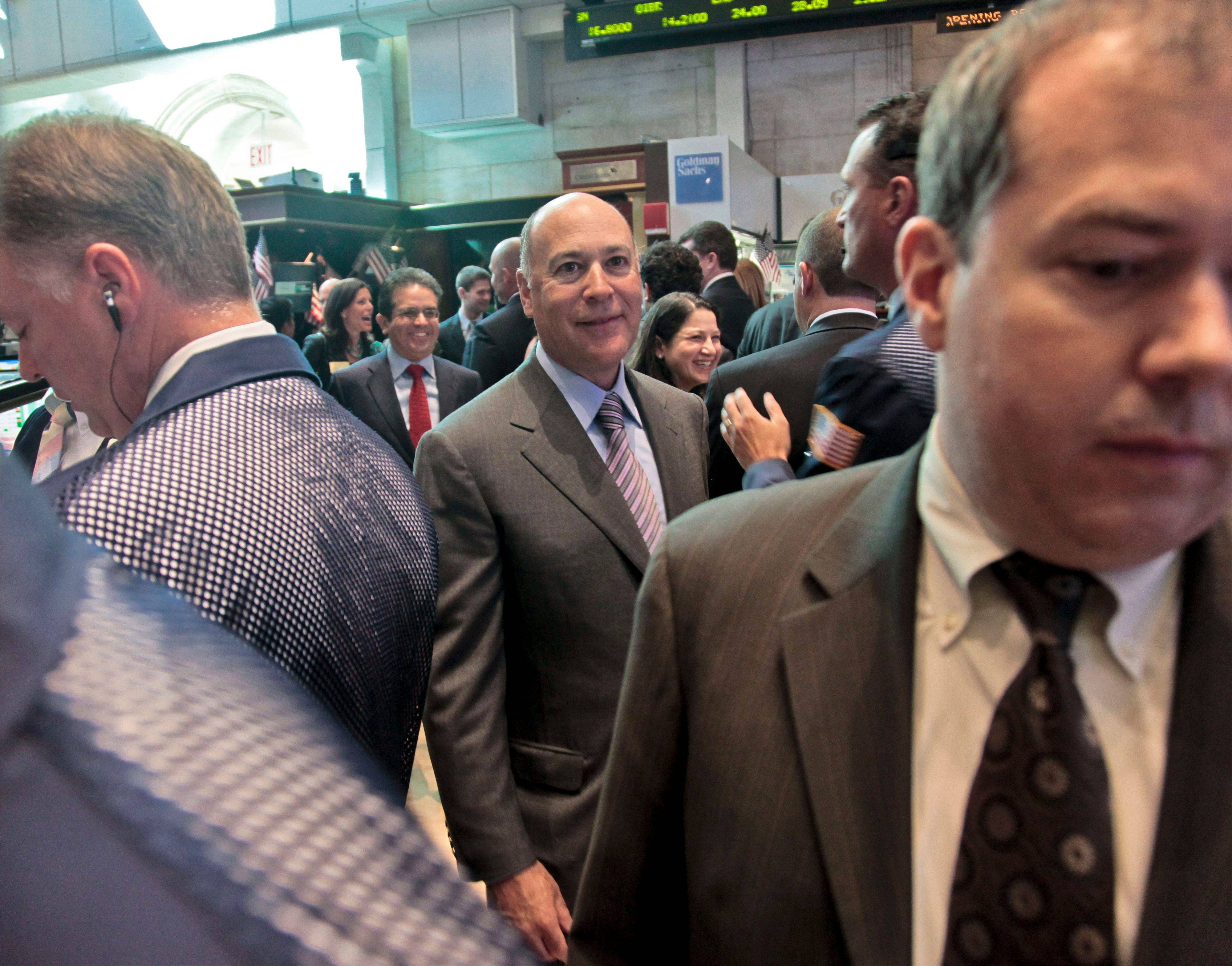 Robert S. Kapito, center, president of the global investment management company BlackRock, leaves after ringing the New York Stock Exchange opening bell to celebrate the 10th anniversary of the creation of the first fixed income exchange traded funds, including iShares, Tuesday.