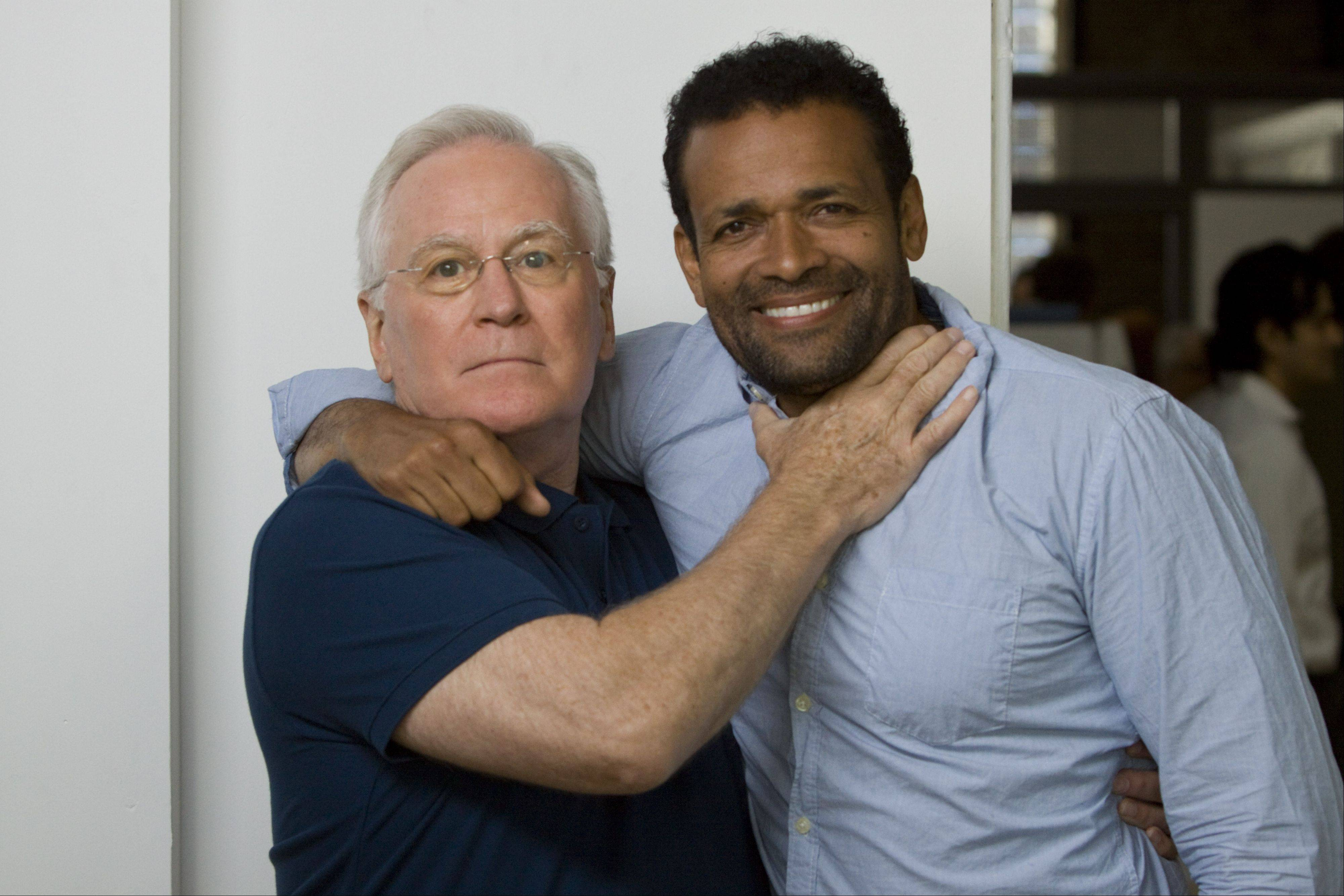 """Boss"" actor and former radio DJ Doug James, of Park Ridge, clowns around with Mario Van Peebles, right, one of the show's directors, while filming the second season this summer in Chicago."
