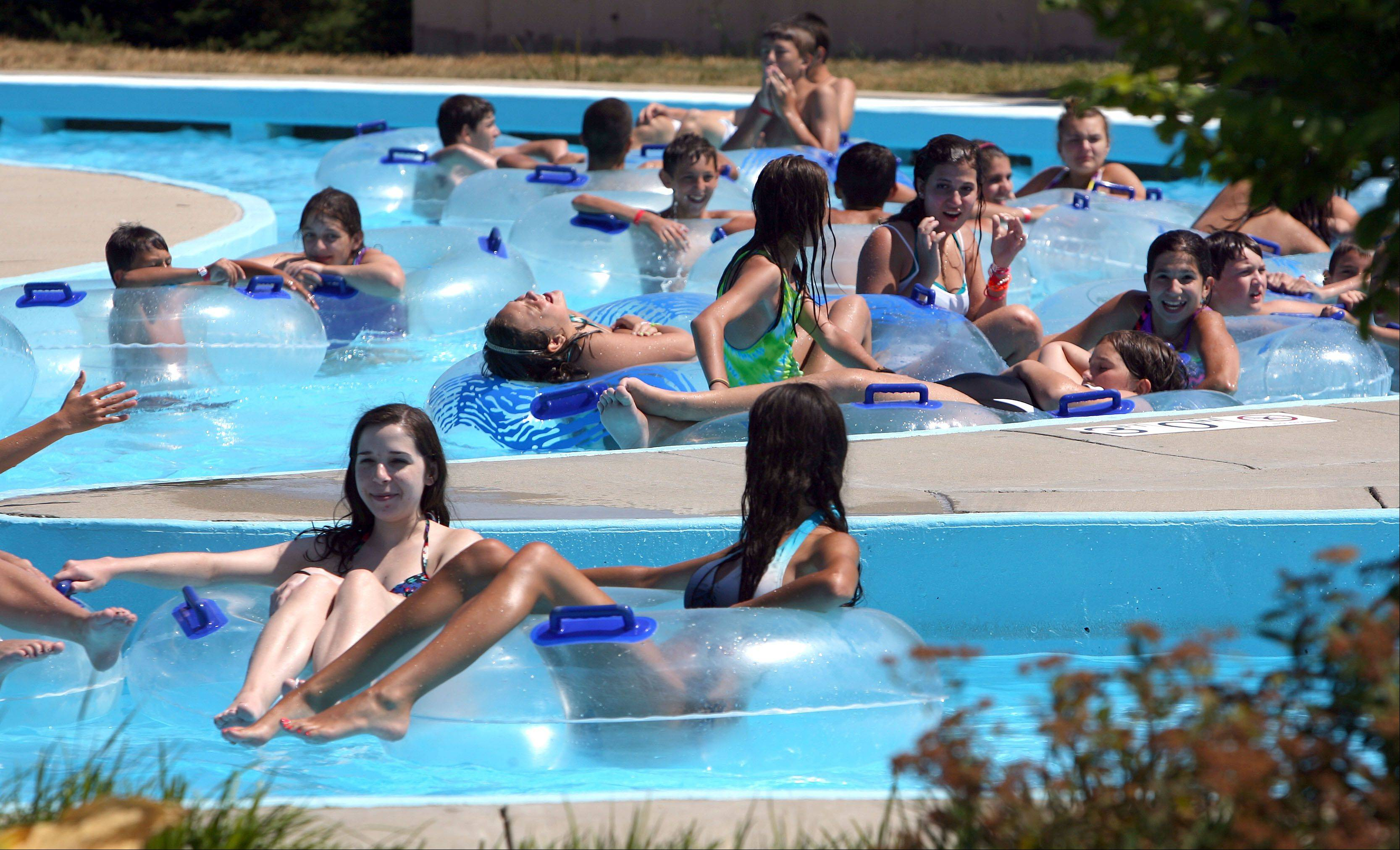 Kids float on tubes in the lazy river Tuesday at Barefoot Bay Family Aquatic Center in Mundelein.