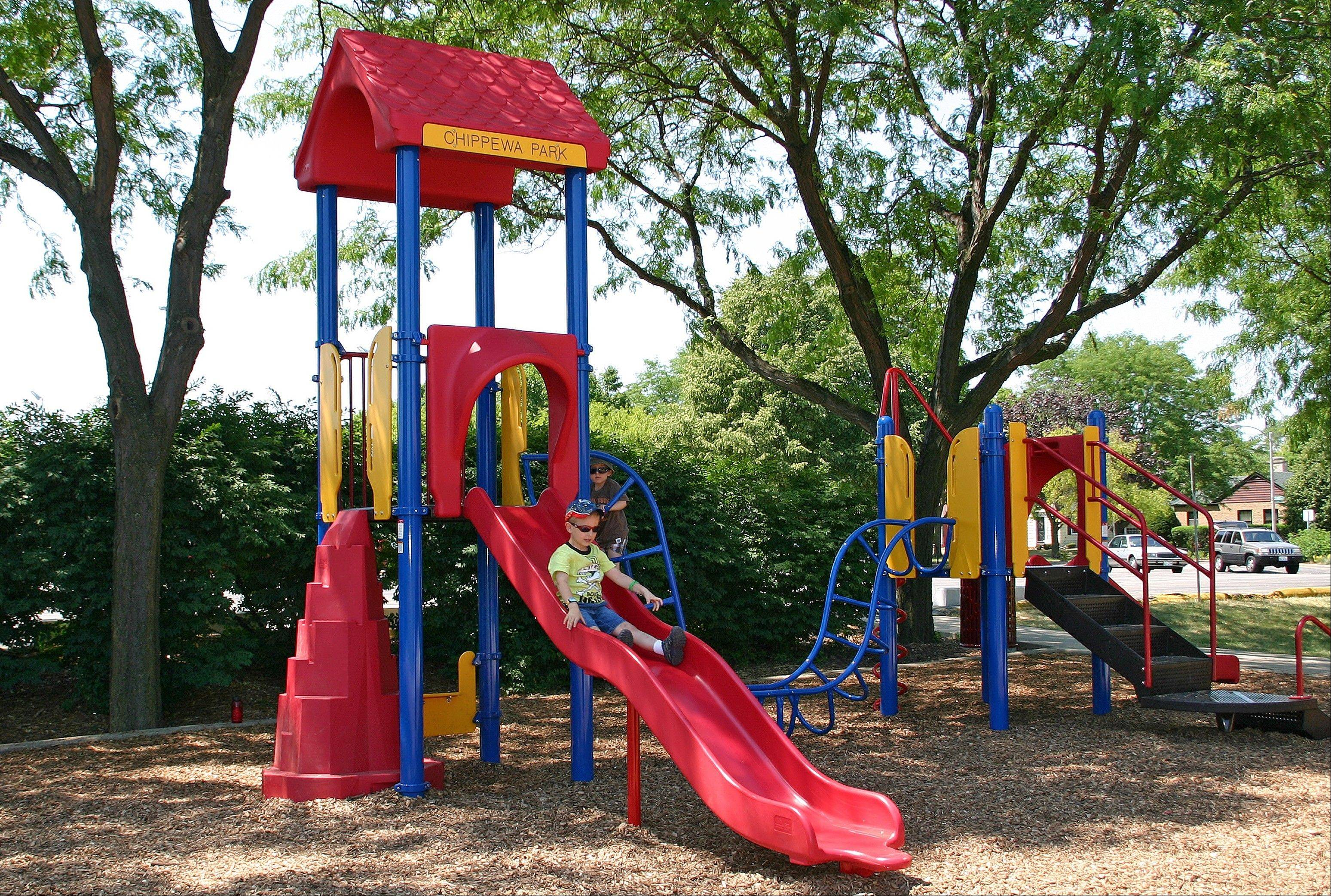 The new playground at Chippewa Park has two slides, four swings, and plenty of places to climb and play.