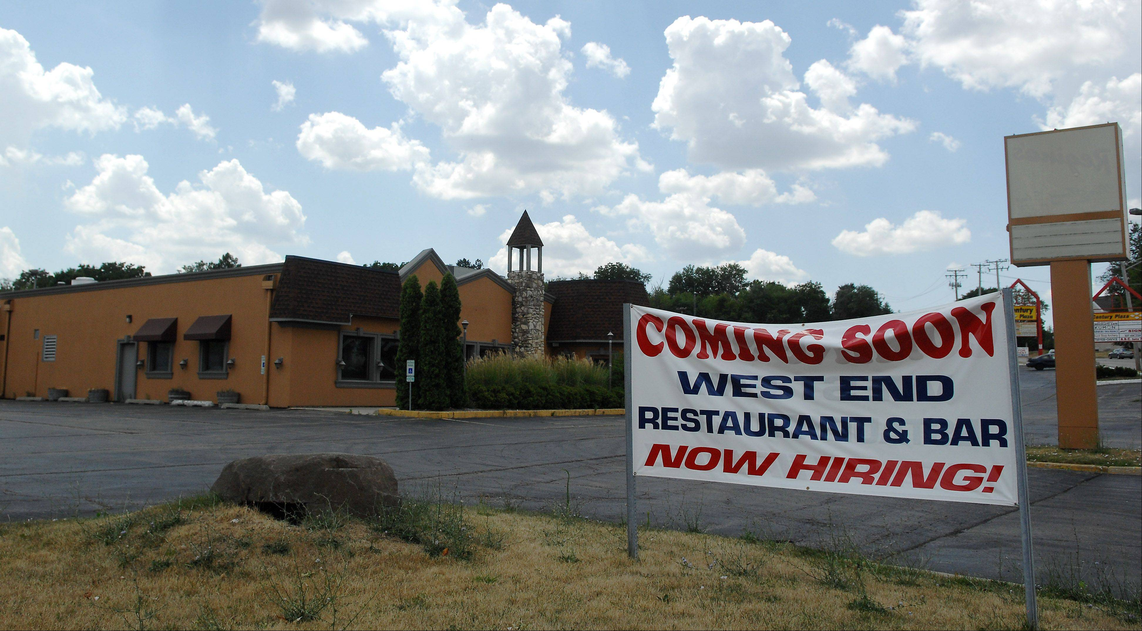 A sign announces that a new tenant will soon take the place of the closed Regina's restaurant in West Dundee.