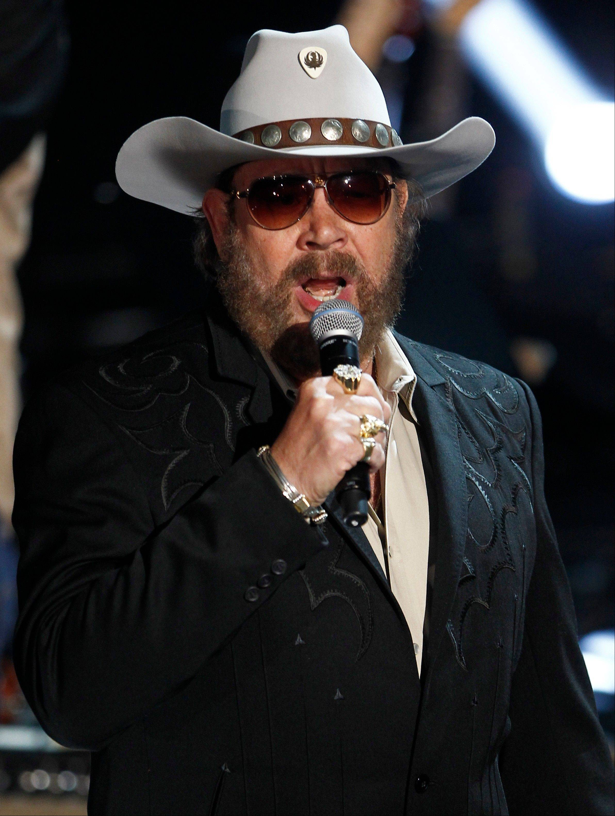 "Hank Williams Jr.'s latest album, ""Old School, New Rules,"" features guest appearances from Merle Haggard and Brad Paisley."