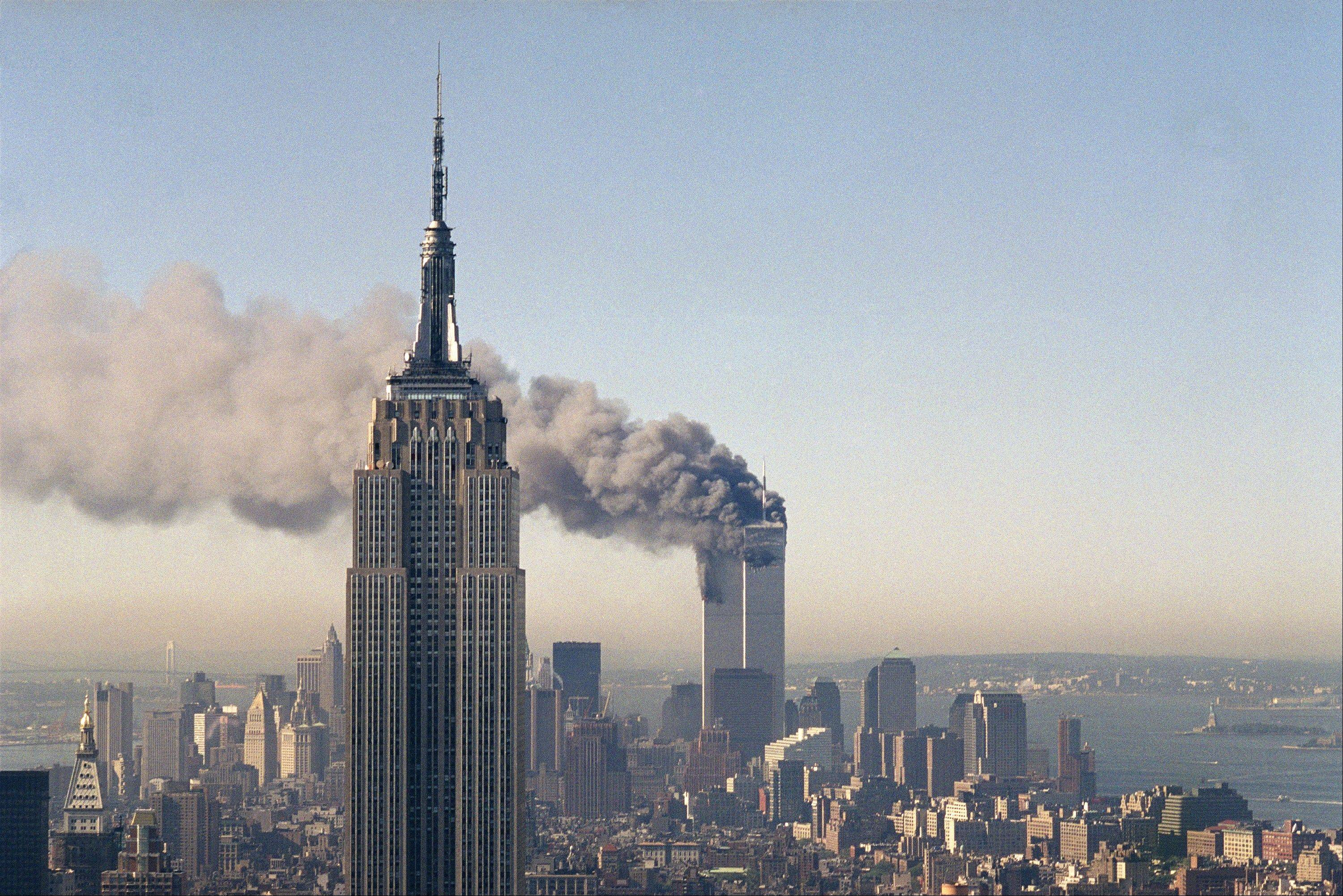 The twin towers of the World Trade Center burn behind the Empire State Building in New York. The Sept. 11, 2001 terrorist attack is by far the most memorable moment shared by television viewers during the past 50 years, according to a new study.