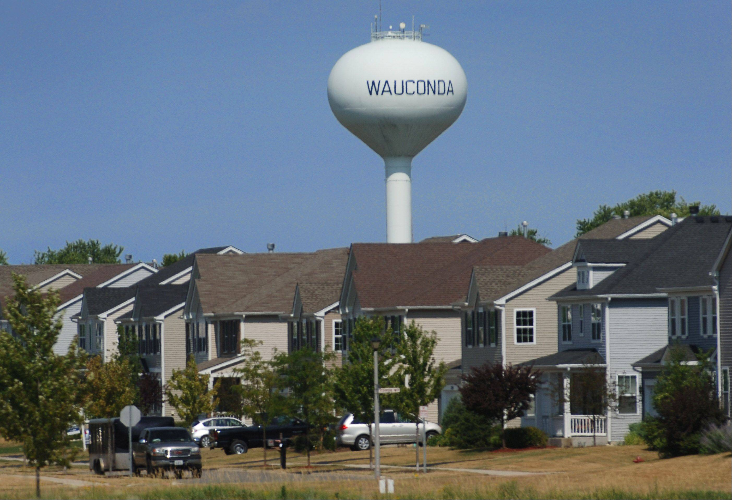 A water tower rises over homes along Gilmer Road in Wauconda.