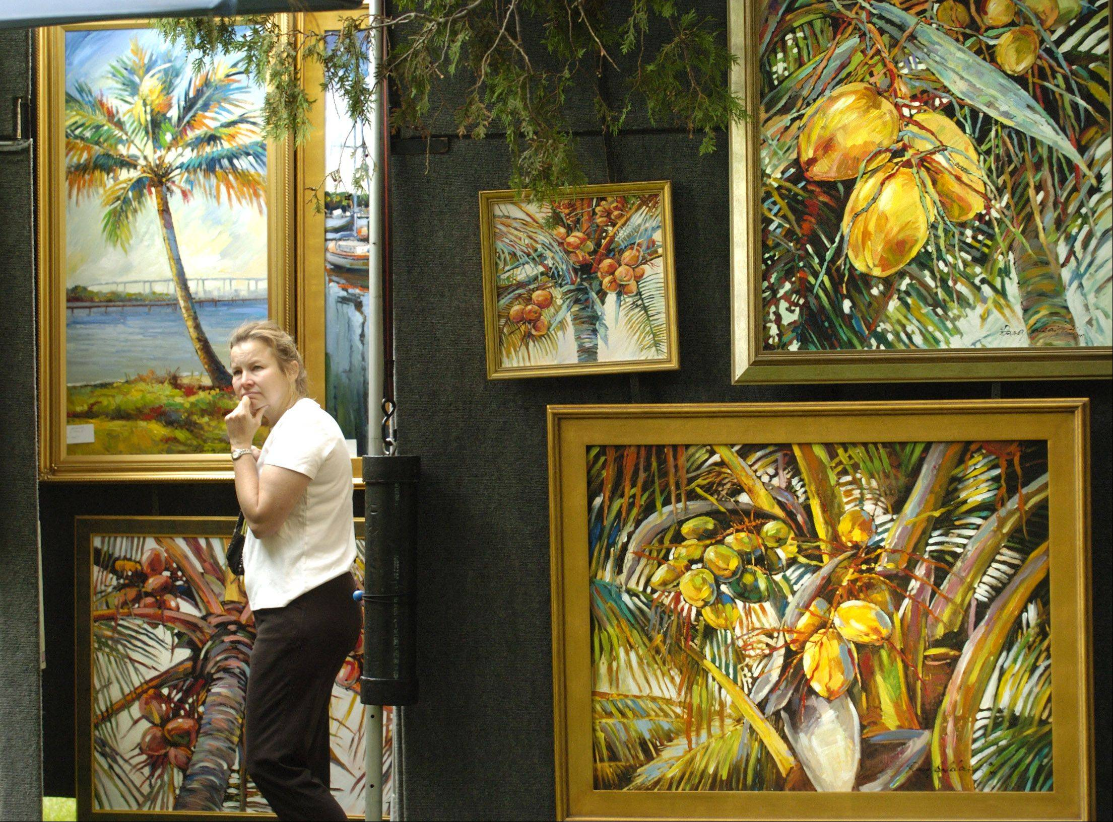 "The annual Fine Arts Fair is the Naperville Woman's Club's largest fundraiser of the year, and the club also donates proceeds to local food pantries. ""The fair has raised money for charitable organizations since it was started,"" said Roxanne Lang, art fair director and special events coordinator."