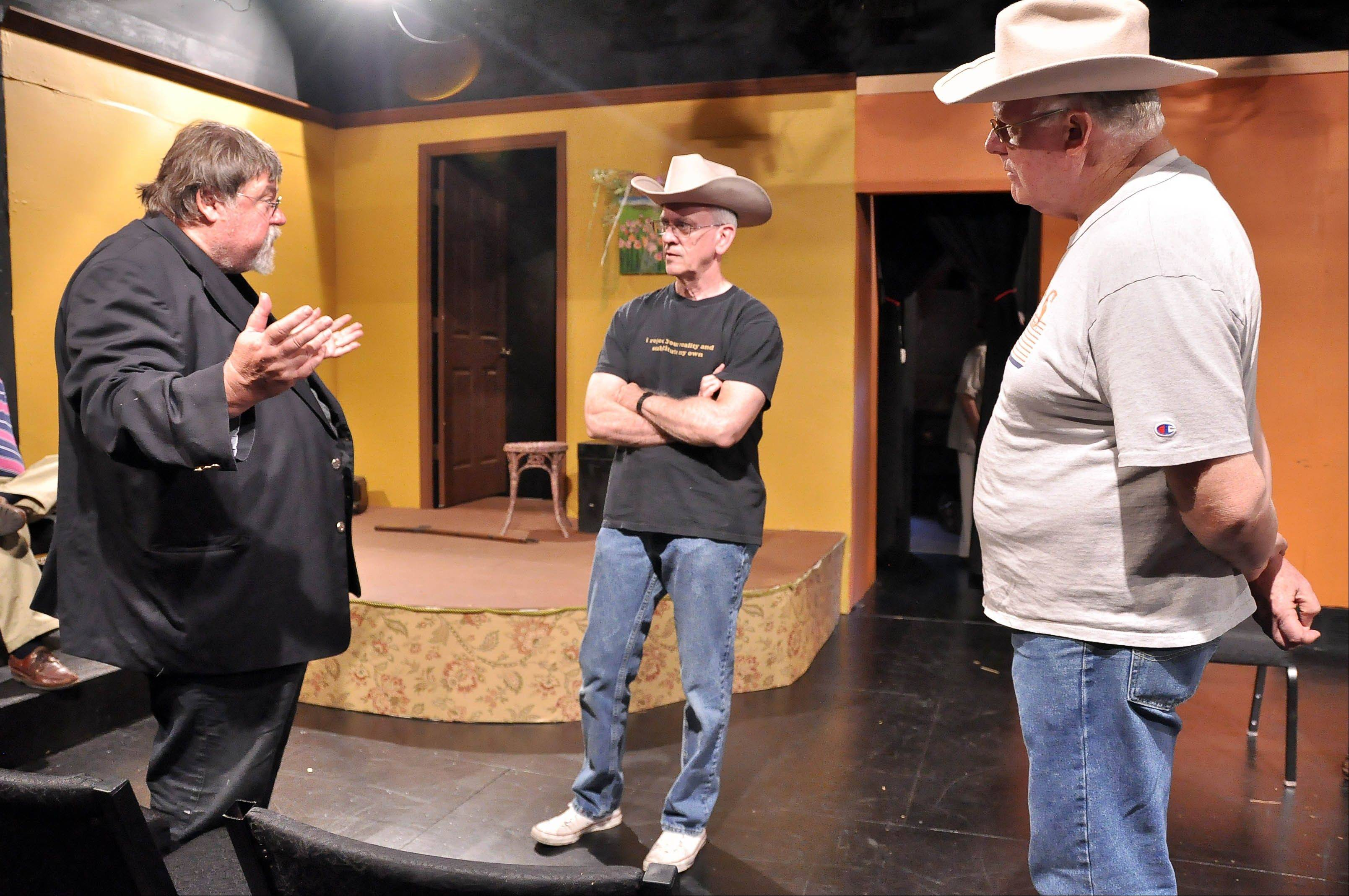 "Bill Burghardt, left, directs Ken Ball, center, and Lee McFadden, right, in ""Oswald: The Actual Interrogation"" opening July 27 at the Village Theatre Guild."