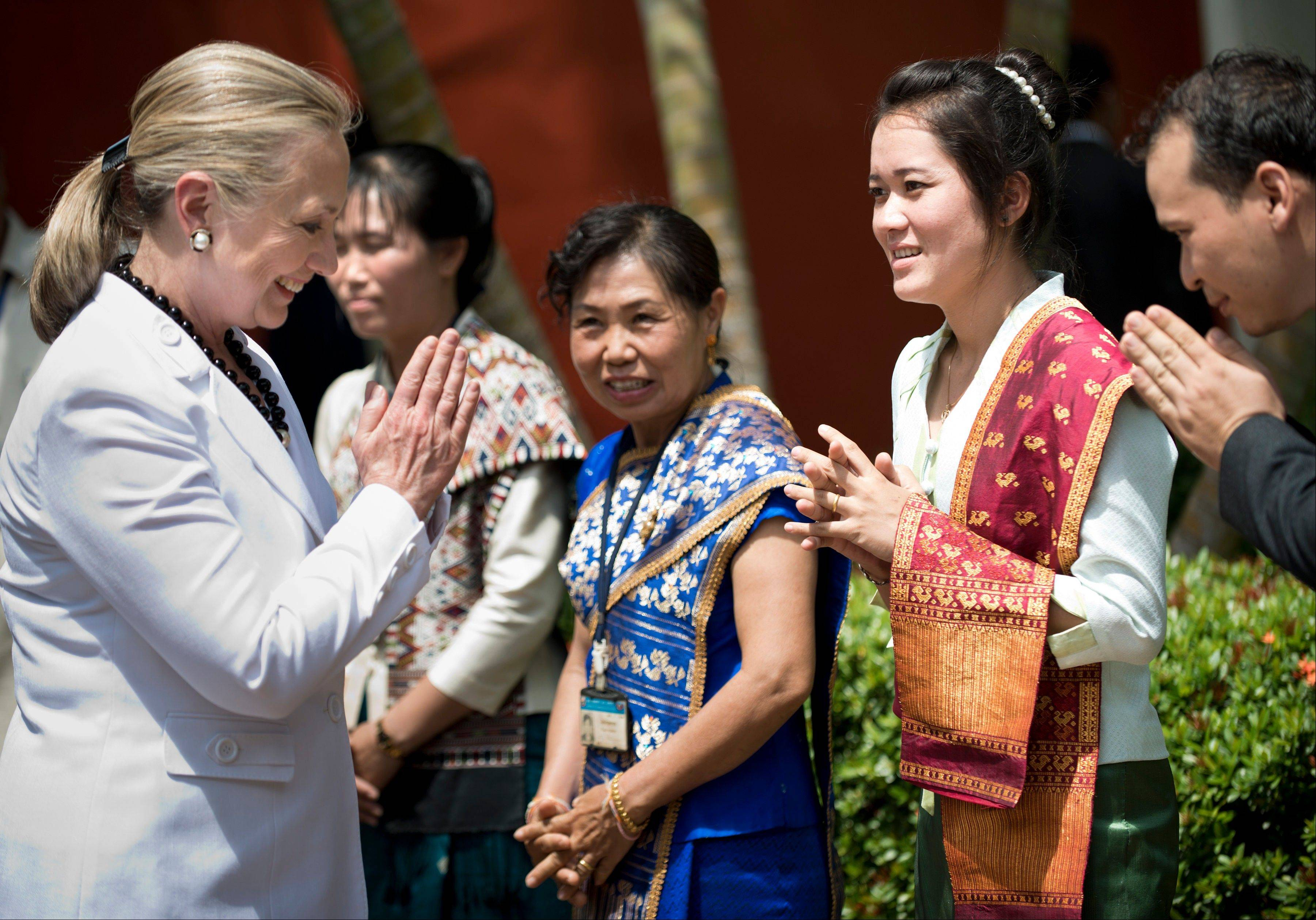 U.S. Secretary of State Hillary Rodham Clinton, left, is greeted at the Ho Phra Keo Temple Wednesday, July 11, 2012 in Vientiane, Laos.