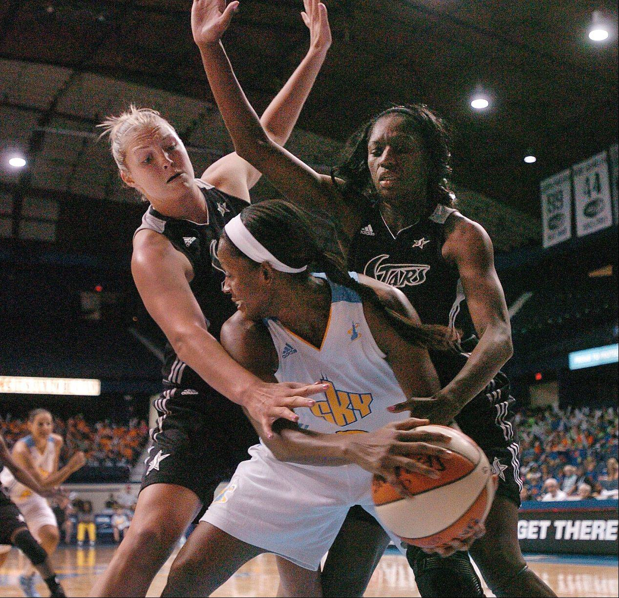 The Chicago Sky's Swin Cash is surrounded by Jane Appel and Shameka Christon of San Antonio, during their game at the Allstate Arena on Wednesday.