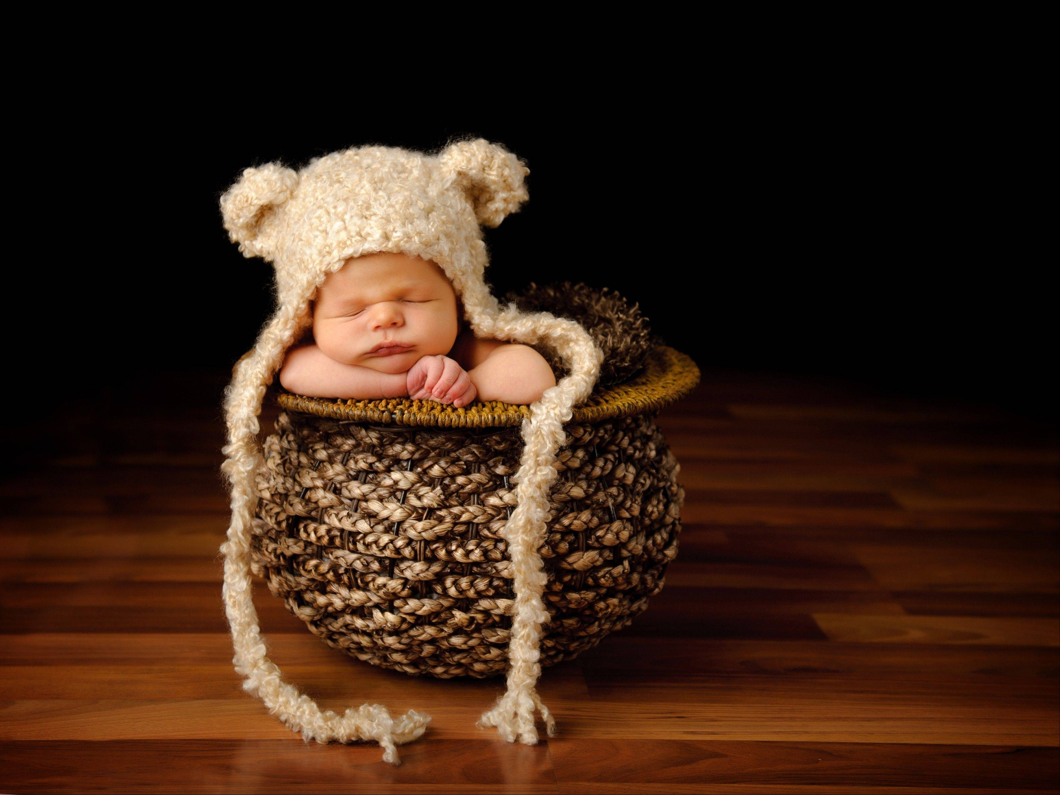 Colton, son of Allison and Dale of Wheaton, is as snug as a bear in a basket.