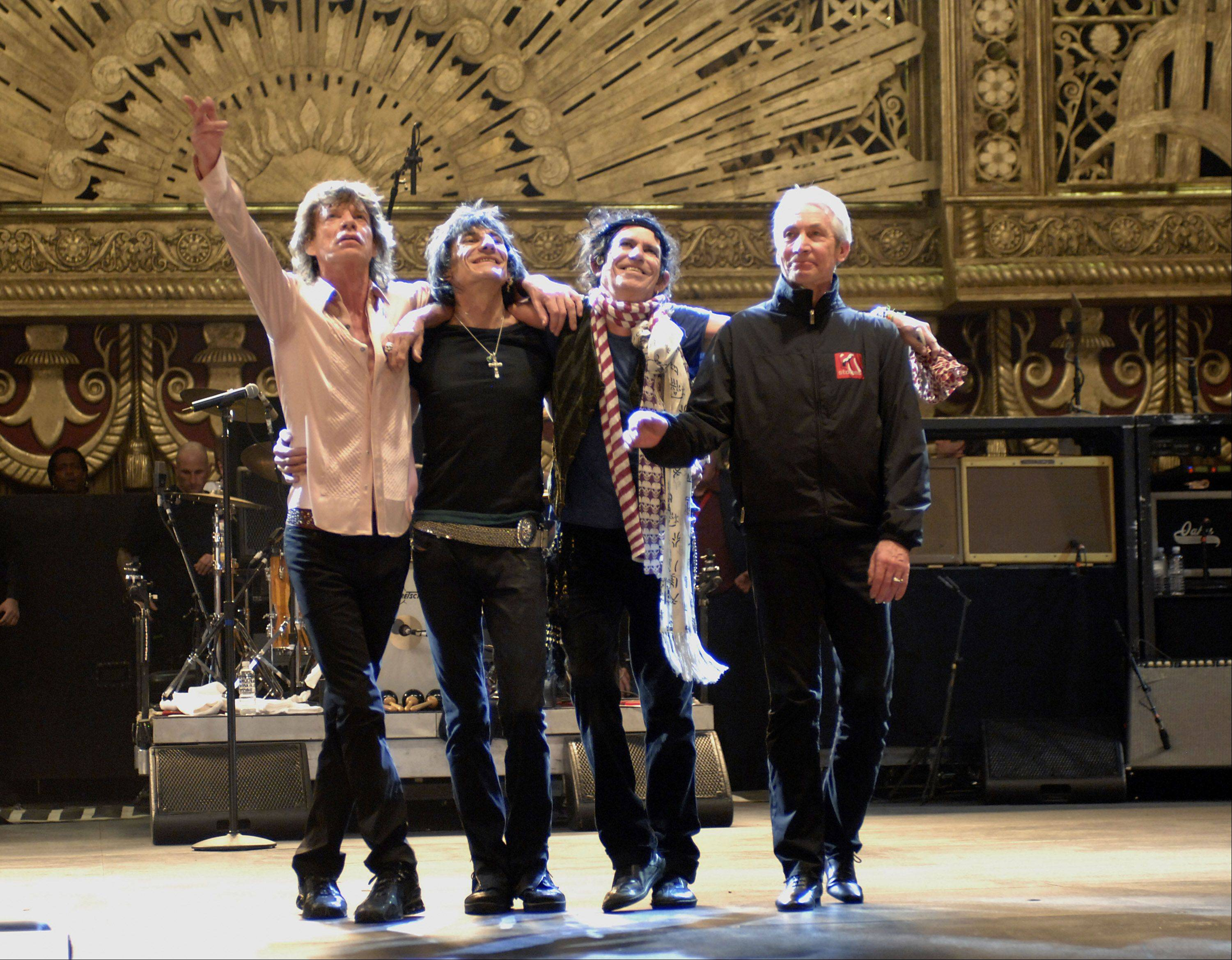 "The Rolling Stones -- subject of the movie ""Shine A Light"" -- are embarking on new projects to mark the band's 50th anniversary. Still together are Mick Jagger, left, Ronnie Wood, Keith Richards and Charlie Watts."