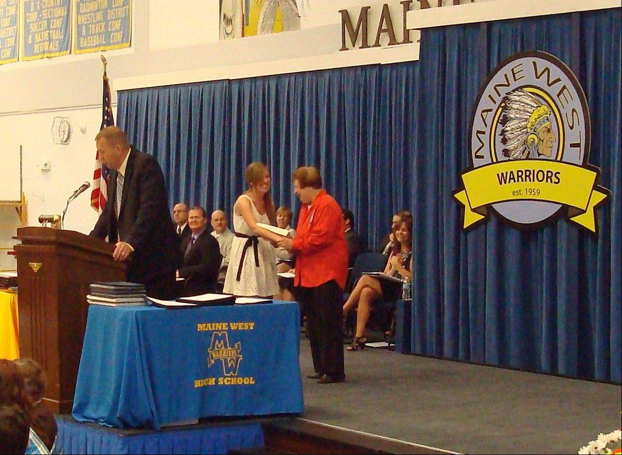 The Maine West DAR Good Citizen Margaret McCabe is congratulated by Twenty First Star Chapter representative Nancy Meyer.