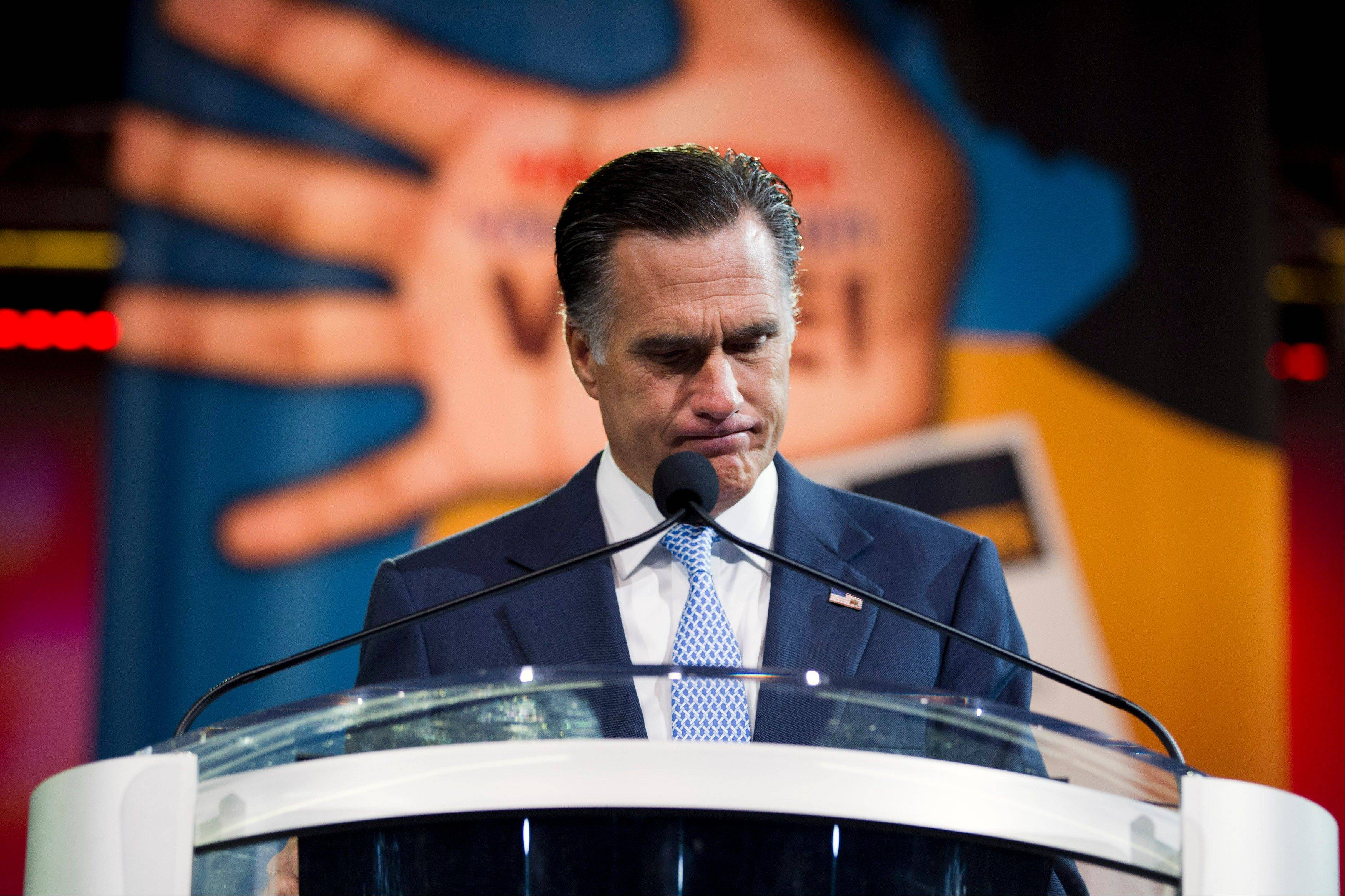 Republican presidential candidate, former Massachusetts Gov. Mitt Romney pauses during a speech before the NAACP annual convention, Wednesday, July 11, 2012, in Houston, Texas.