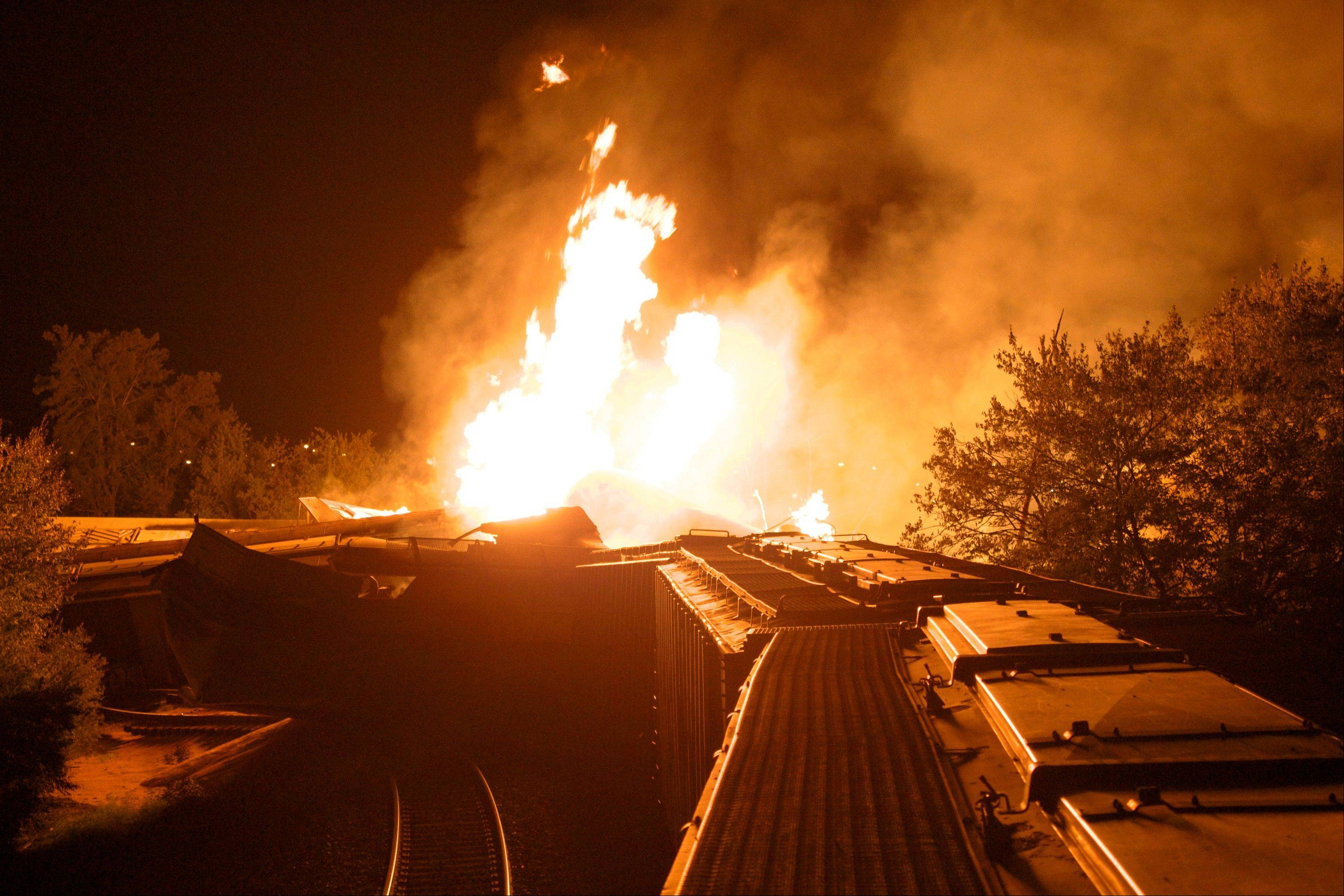 Flames rise from a derailed freight train early Wednesday in Columbus, Ohio.