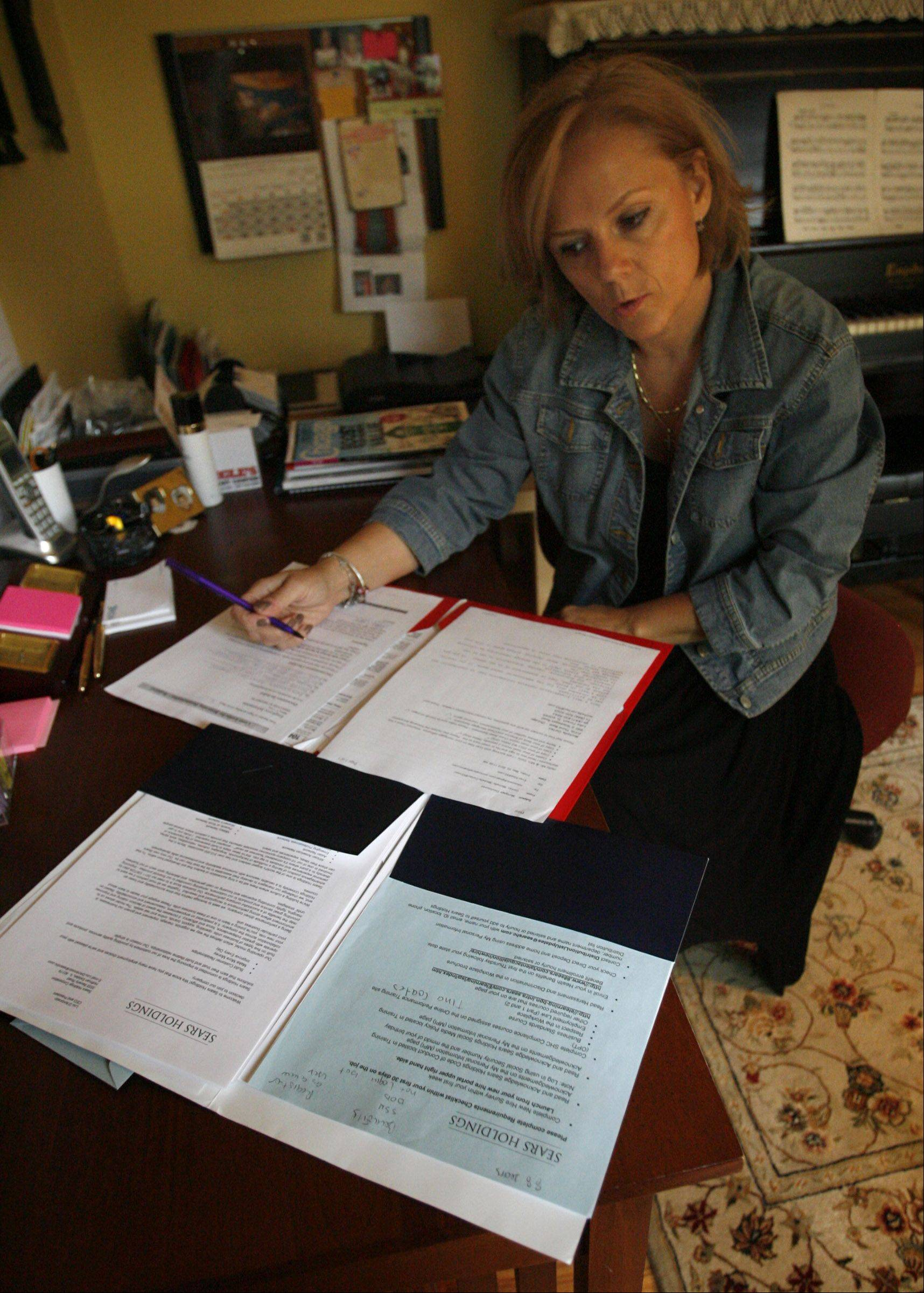Valeria Coric reviewing mortgage paperwork at her home in Lincolnshire.