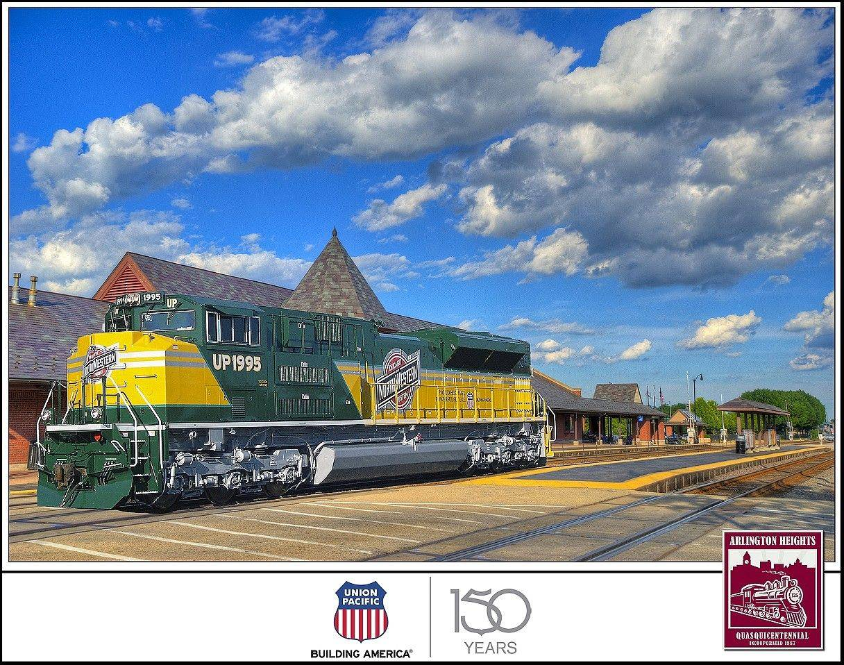 The C&NW Heritage locomotive rolls through downtown Arlington Heights.