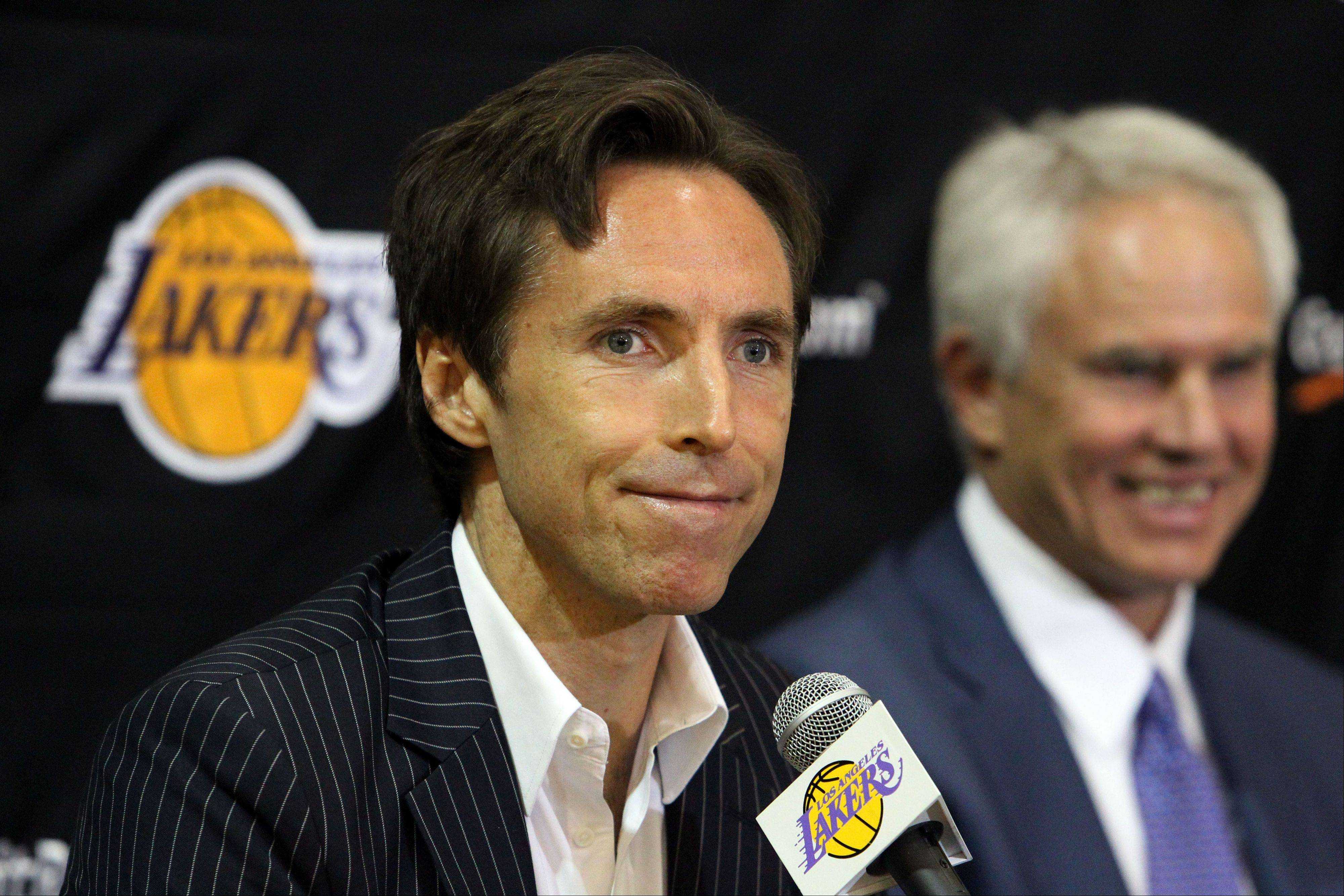 Newly-acquired Los Angeles Lakers guard Steve Nash, left, and general manager Mitch Kupchak appear Wednesday at a news conference at the team's headquarters in El Segundo, Calif. The Lakers acquired the two-time MVP from the Phoenix Suns in exchange for first round draft picks in 2013 and 2015 as well as second round draft picks in 2013 and 2014.