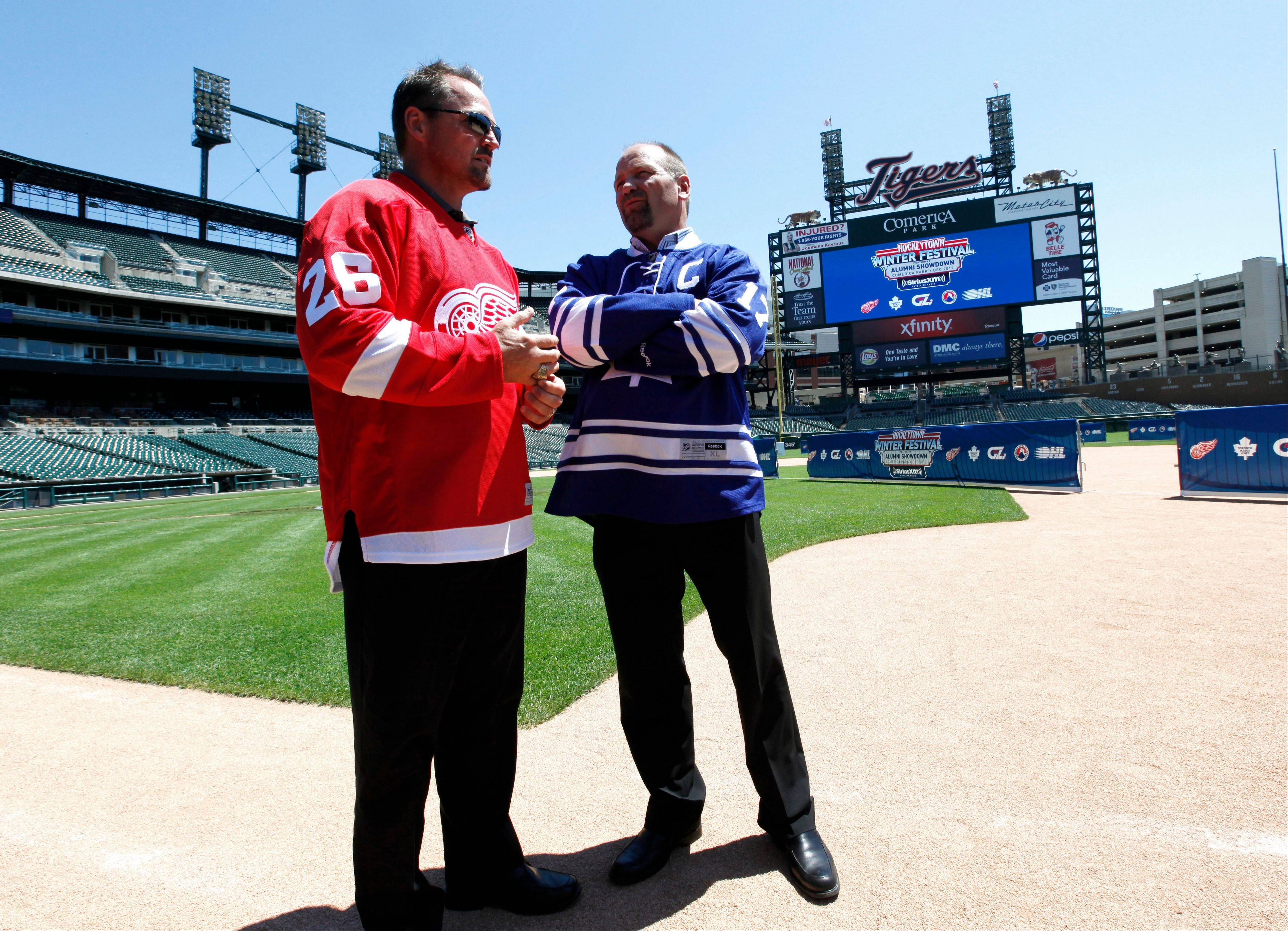 Former Detroit Red Wings player Joe Kocur, left, and former Toronto Maple Leafs player Wendel Clark took part in a news conference at Comerica Park in Detroit to announce the preliminary rosters for the Toronto Maple Leafs-Detroit Red Wings Alumni Showdown hockey game on Dec. 31. The two NHL clubs will also play in the Winter Classic at Michigan Stadium on Jan. 1.