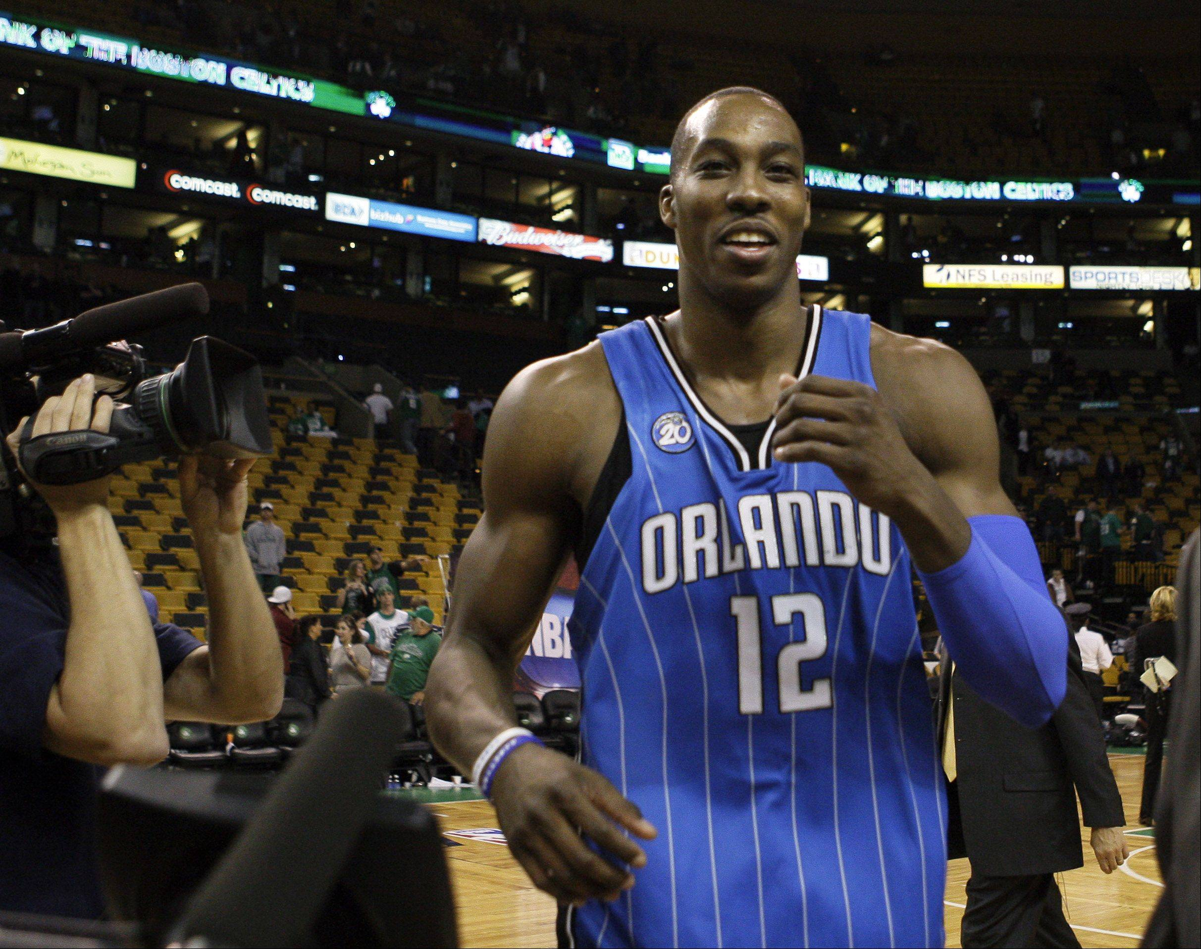 "Orlando Magic Rob Hennigan said Wednesday that trade talks involving Dwight Howard with the Brooklyn Nets are ""stationary,"" but that discussions remain open with them and other teams."