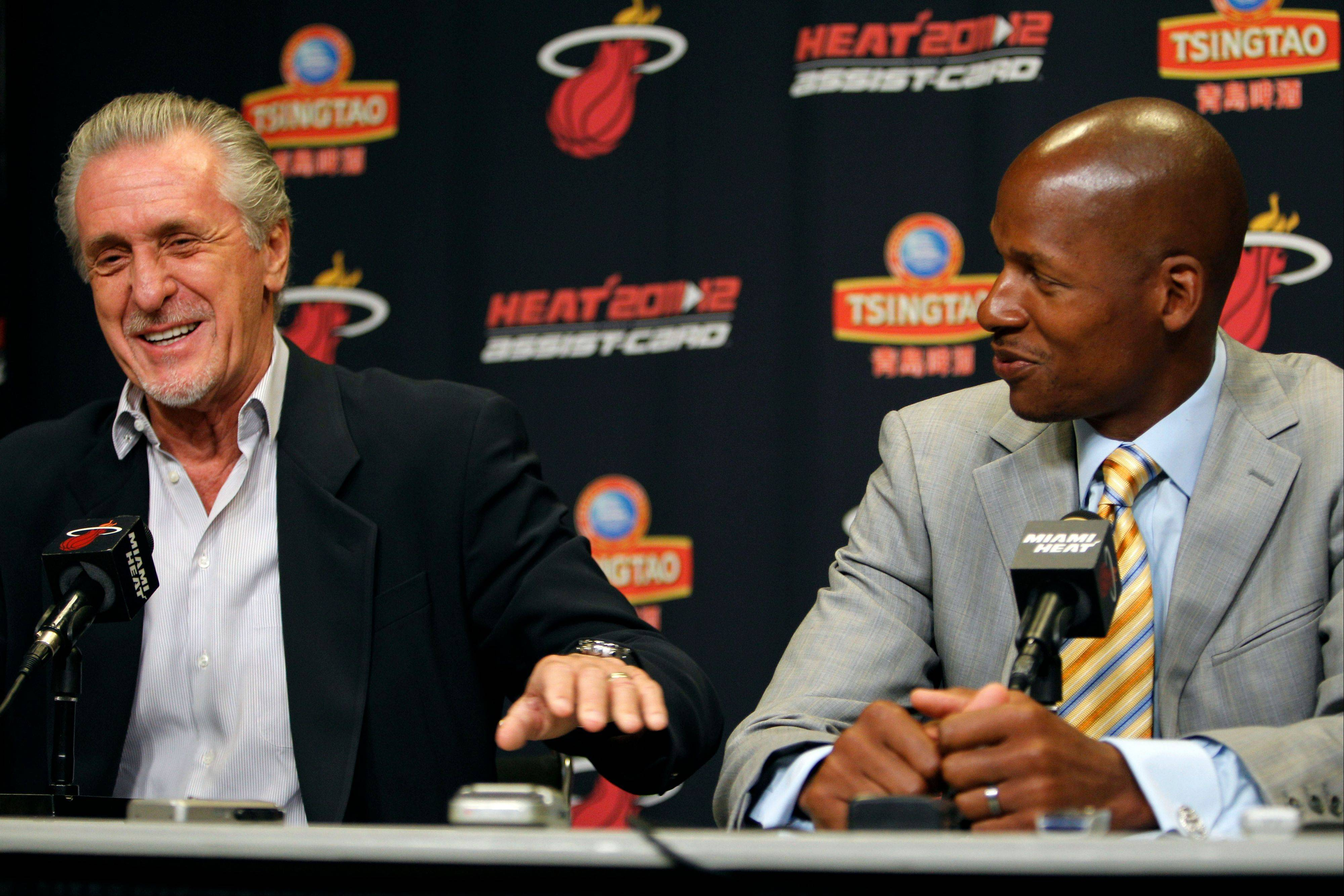 Miami Heat president Pat Riley, left, sits with guard Ray Allen, right, Wednesday during a news conference after Allen signed a contract with the Heat.