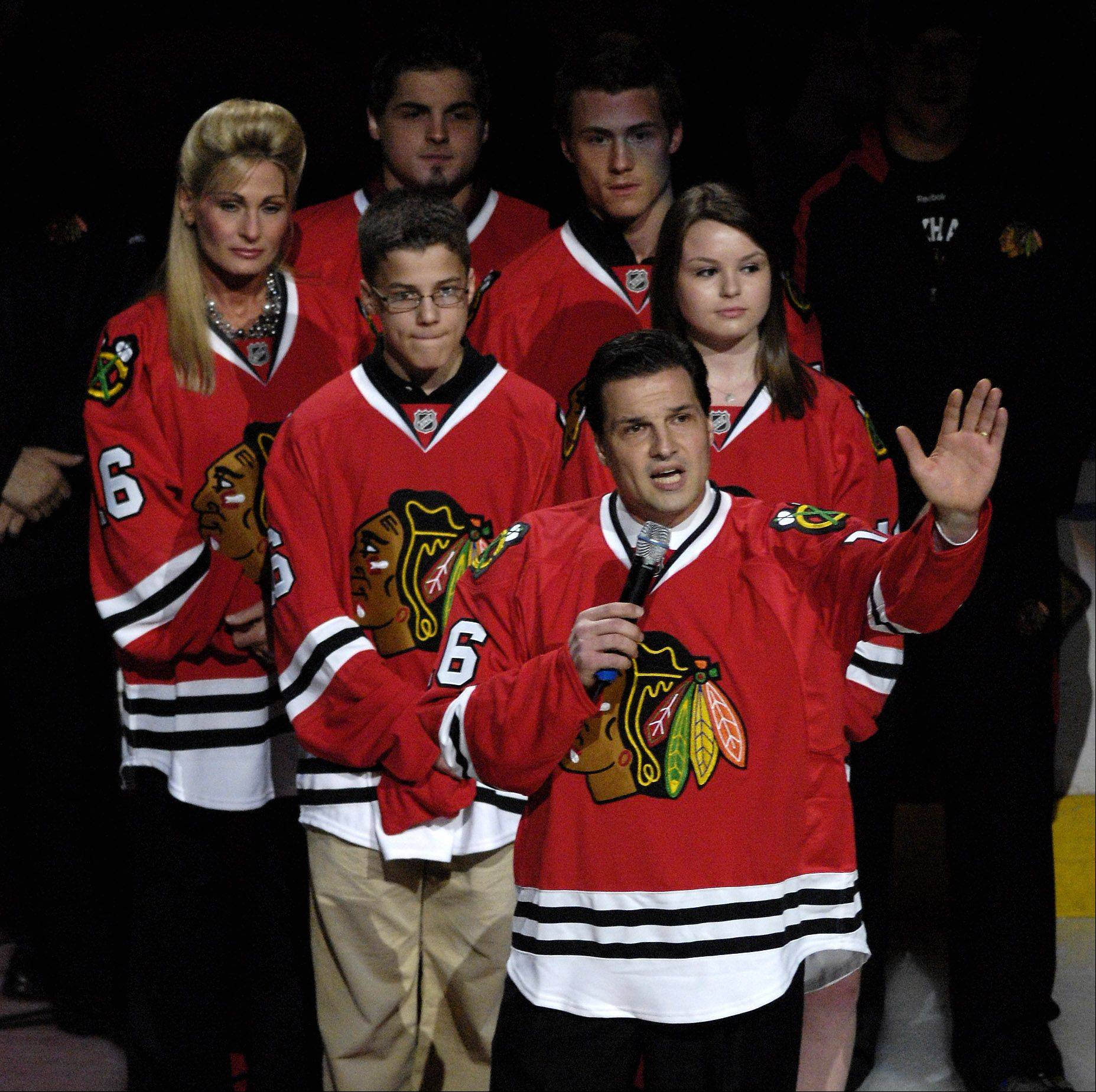 The Chicago Blackhawks honored Eddie Olczyk, front, with a special night during the 2009-10 season, and now the U.S. Hockey Hall of Fame will induct him this fall.