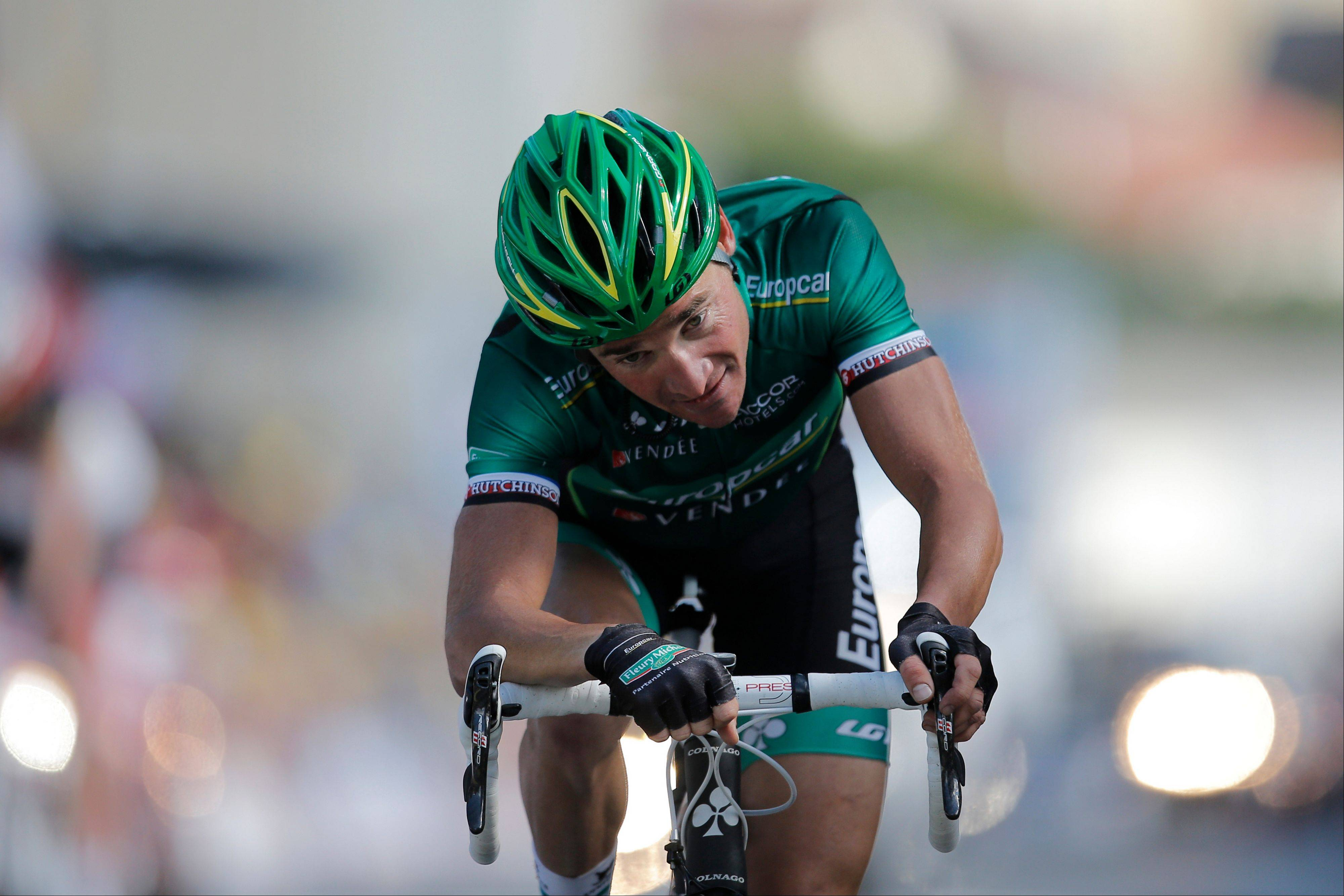 Thomas Voeckler crosses the finish line Wednesday to win the 10th stage of the Tour de France.