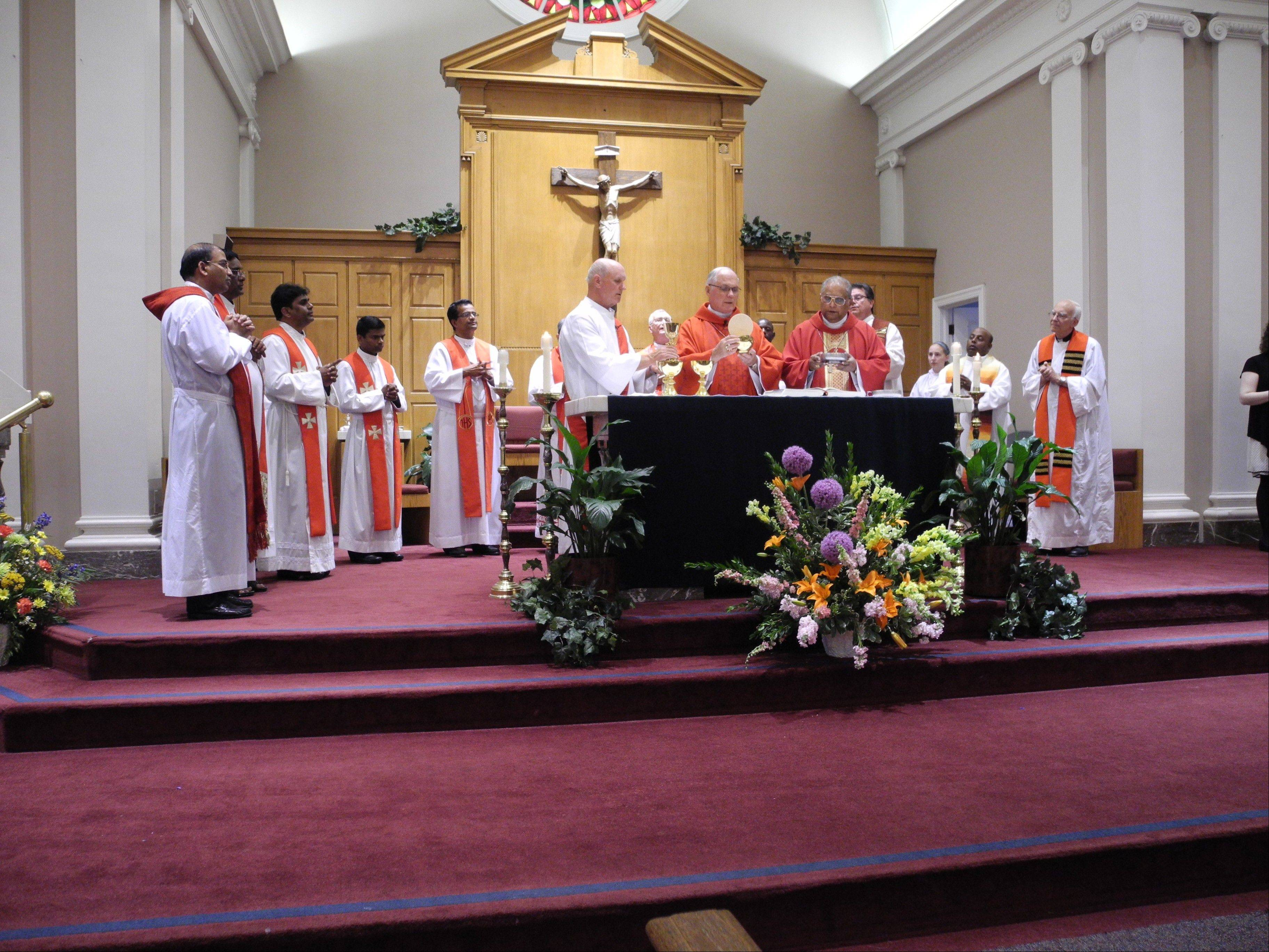 Most Rev. George Rassas, auxiliary bishop of the Archdiocese of Chicago and Most Rev. Gali Bali, bishop of Guntur, India, were celebrants of a Mass at St. James Catholic Church in Arlington Heights to mark FCN's 10th anniversary.