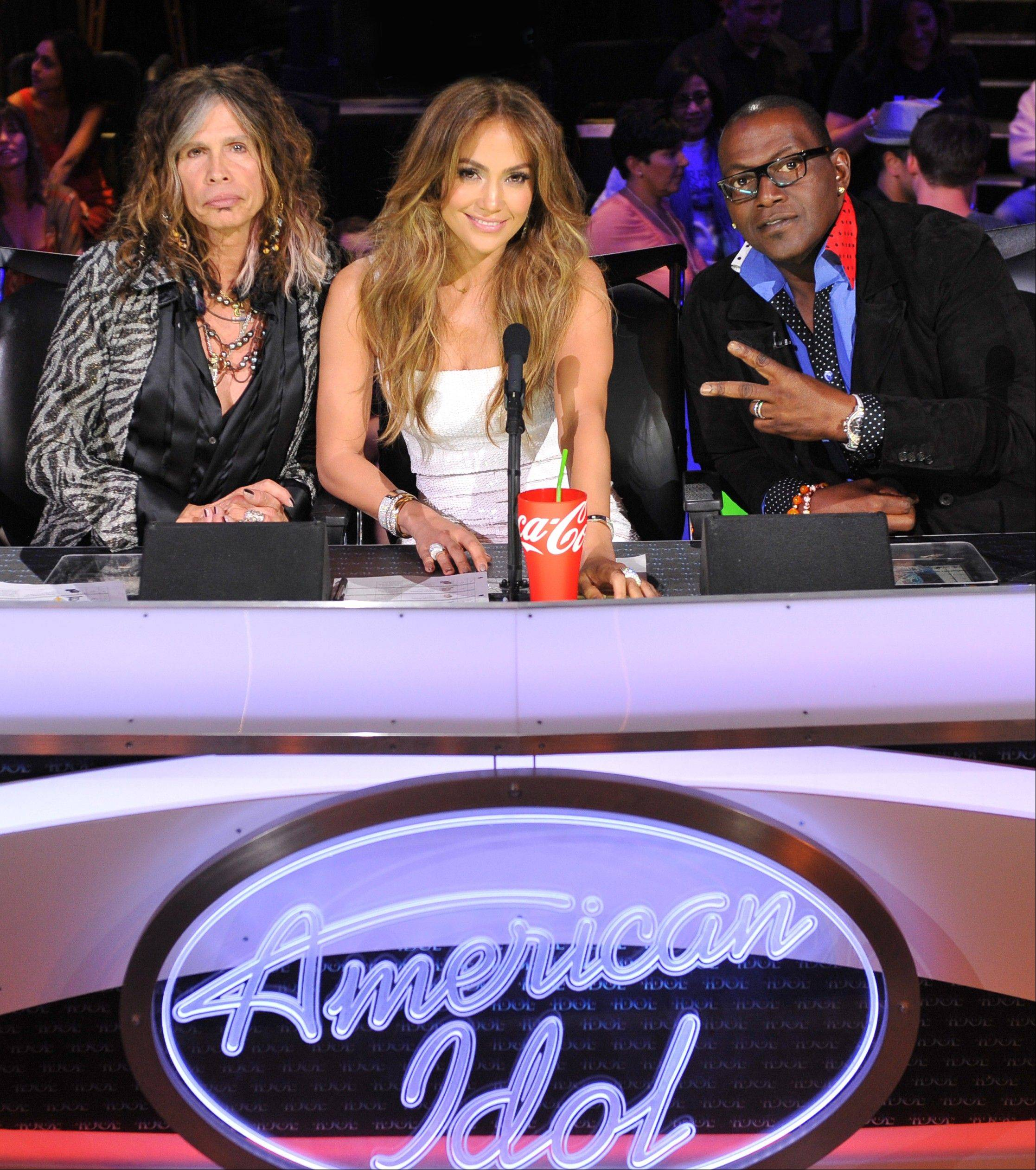 �American Idol� judges, from left, Steven Tyler, Jennifer Lopez and Randy Jackson are shown on the set of the singing competition series, �American Idol,� in Los Angeles. Tyler announced Thursday that he will not be returning as a judge on the singing competition series �American Idol.� Tyler served as a judge with singer/actress Jennifer Lopez and Randy Jackson on the 10th and 11th season of the series.
