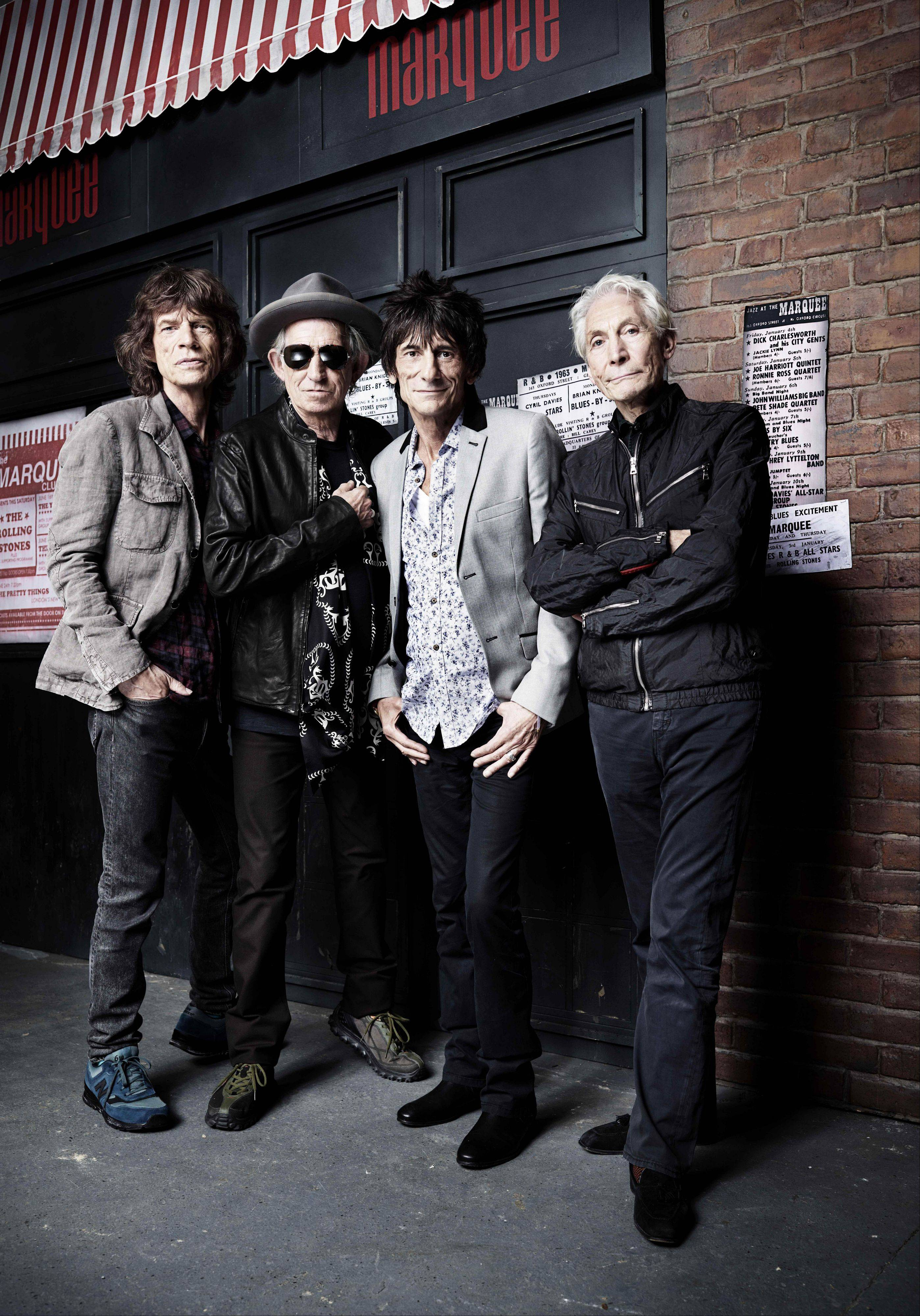 The rock band the Rolling Stones, from left, Mick Jagger, Keith Richards, Ronnie Wood and Charlie Watts marked the 50th anniversary of their first-ever live performance at the Marquee club in London.