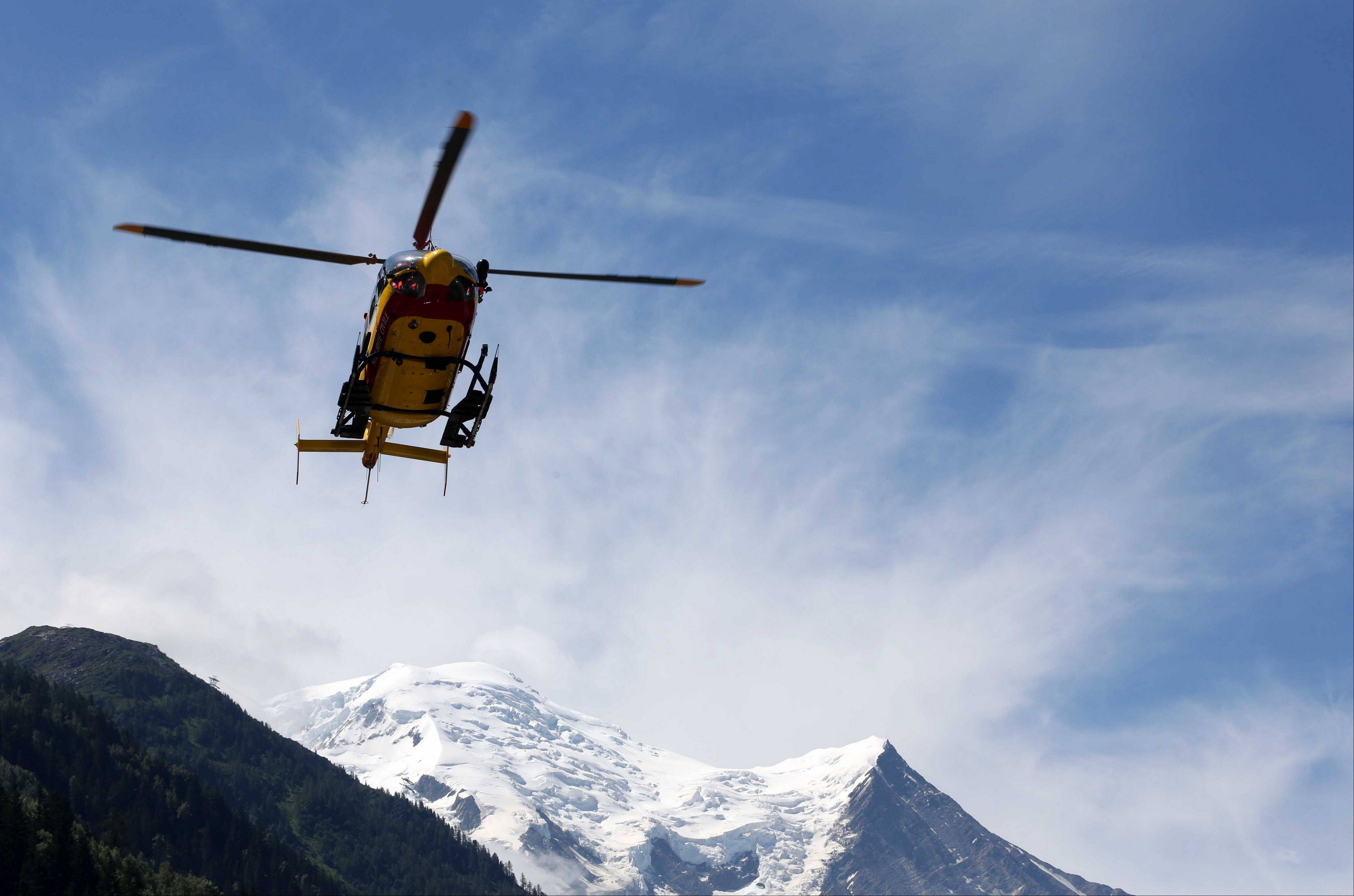 A rescue worker helicopter returning from the avalanche site, lands in Chamonix, French Alps, Thursday, July, 12, 2012. A slab of ice broke off Thursday high in the French Alps, sparking an avalanche that swept nine Europeans to their deaths as they tried to climb Mont Blanc, authorities said. Eleven other climbers were hospitalized and at least four are still unaccounted for.