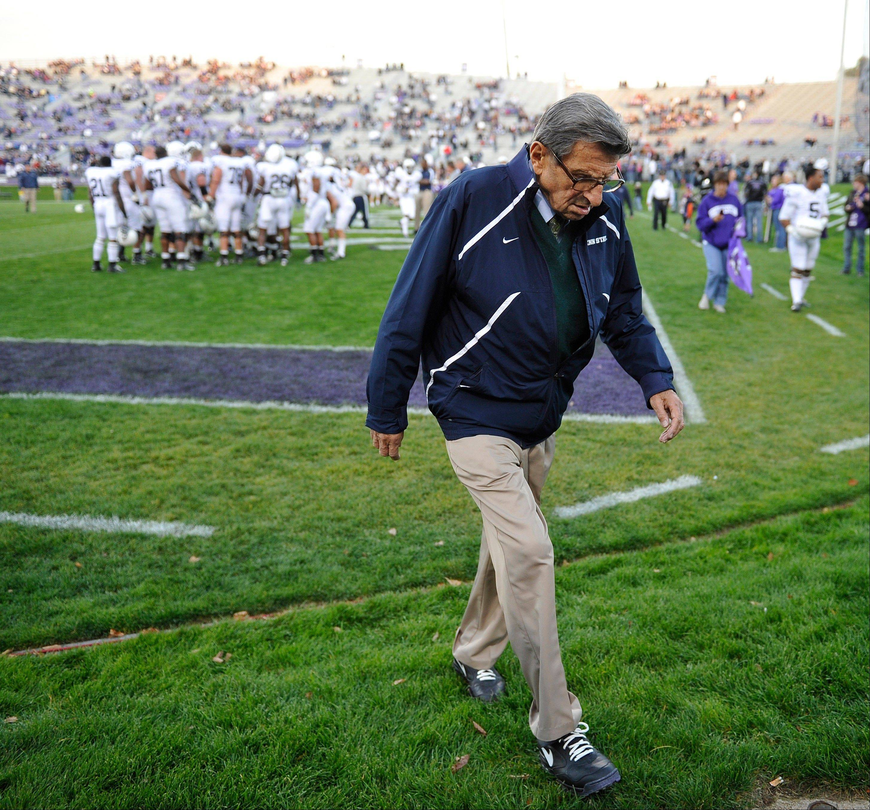 "Penn State coach Joe Paterno walks off the field after warmups before Penn State's game at Northwestern. Paterno and other senior Penn State officials ""concealed critical facts"" about Jerry Sandusky's child abuse because they were worried about bad publicity, according to an internal investigation into the scandal released Thursday."
