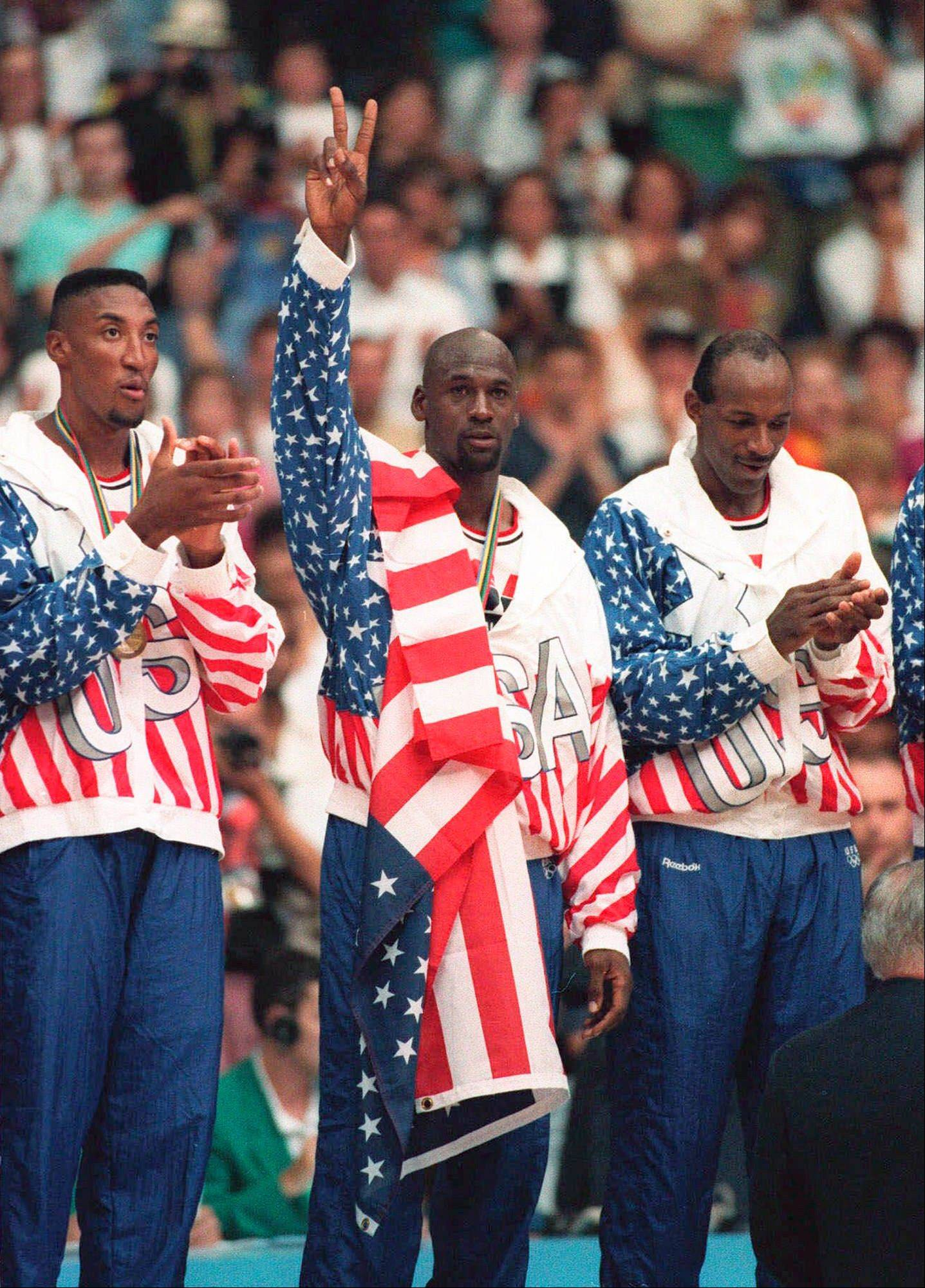 Team USA�s Scottie Pippen, left, with Michael Jordan and Clyde Drexler, pose with their gold medals after beating in Barcelona in the 1992 Olympic Games. Jordan tells the Associated Press that he laughed when heard Kobe Bryant said this year�s USA Olympic basketball team could beat the Dream Team that Jordan played on.