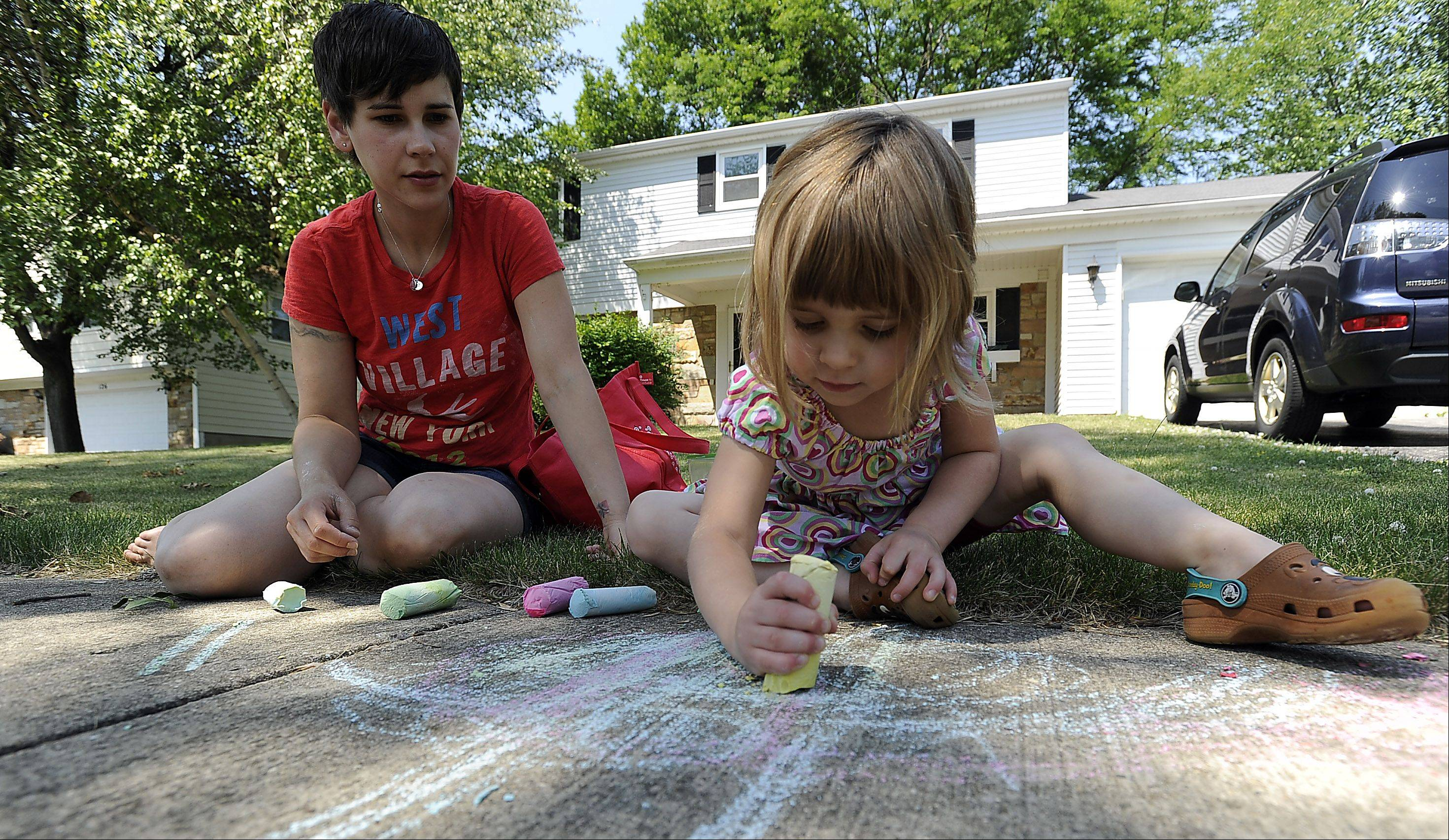 Rebecca Anderson, and her daughter, Lily, 4, enjoy the sidewalk chalk made from scratch.