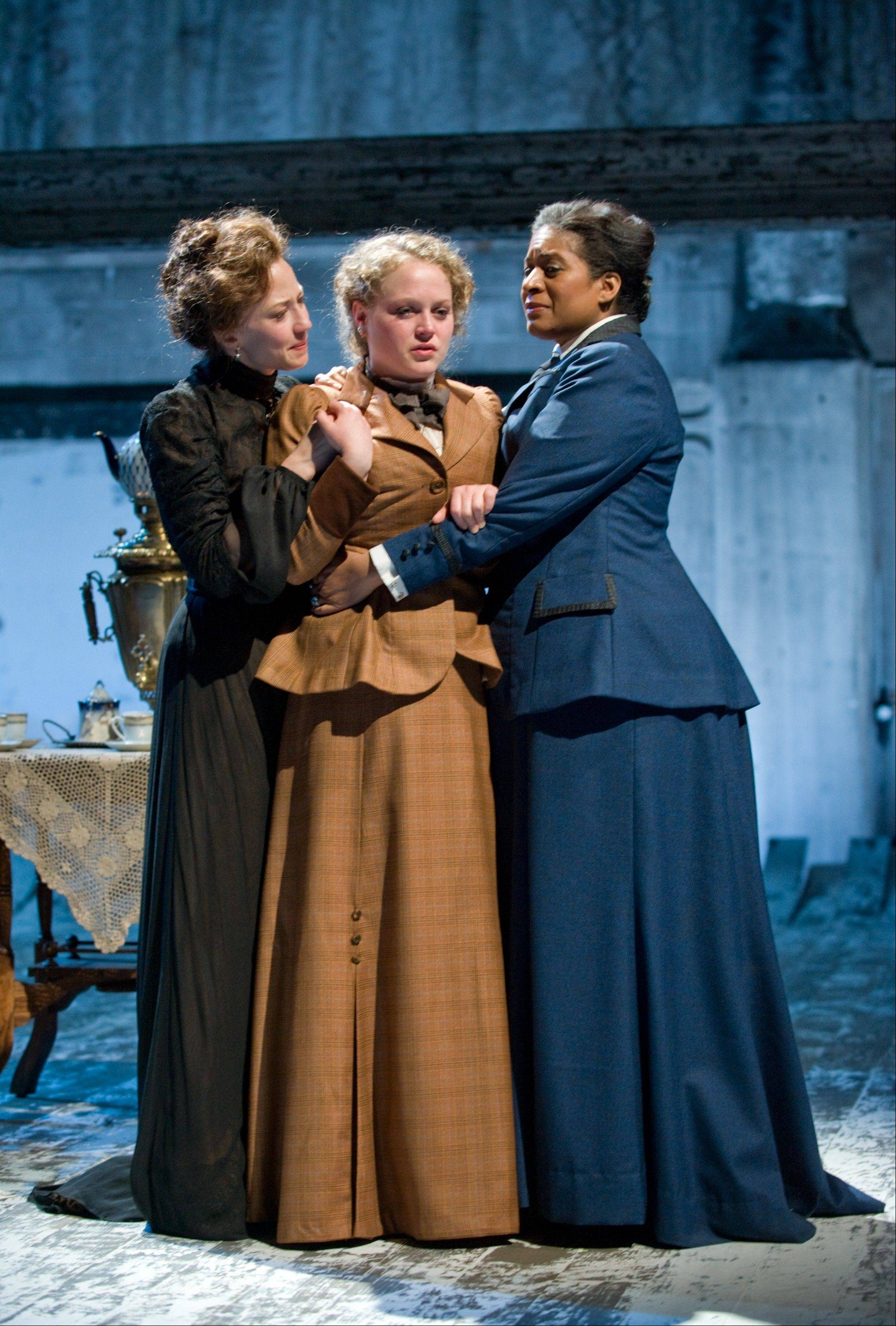 "Sisters Masha (Carrie Coon, left), Irina (Caroline Neff, center) and Olga (Ora Jones) yearn to leave their provincial home for Moscow in Tracy Letts' modern take on ""Three Sisters,"" Anton Chekhov's timeless examination of inertia."