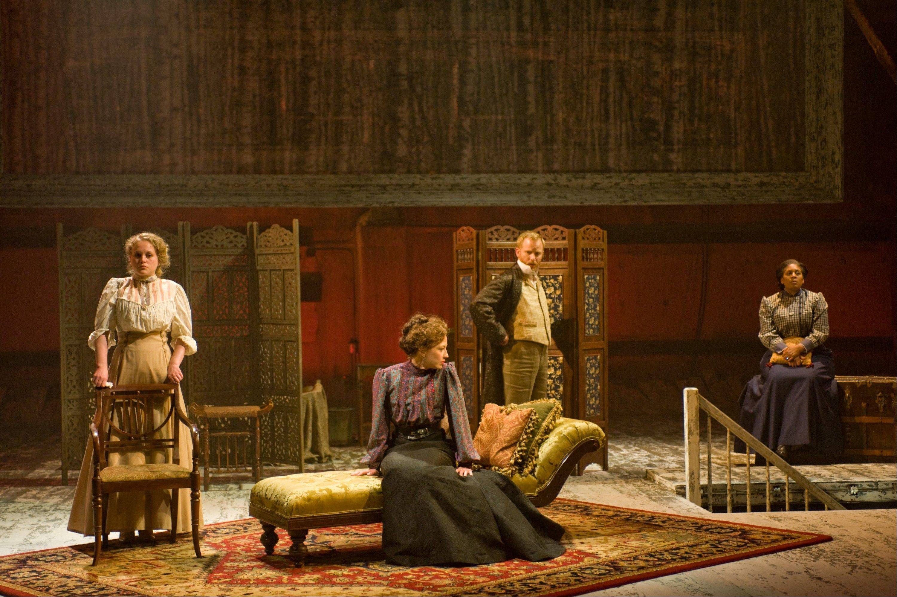 "Andrey (Dan Walker, second from right) confronts his despairing sisters Irina (Caroline Neff, left), Masha (Carrie Coon, second from left) and Olga (Ora Jones) in Steppenwolf Theatre's production of Anton Chekhov's ""Three Sisters,"" directed by Anna D. Shapiro from Tracy Letts' adaptation."