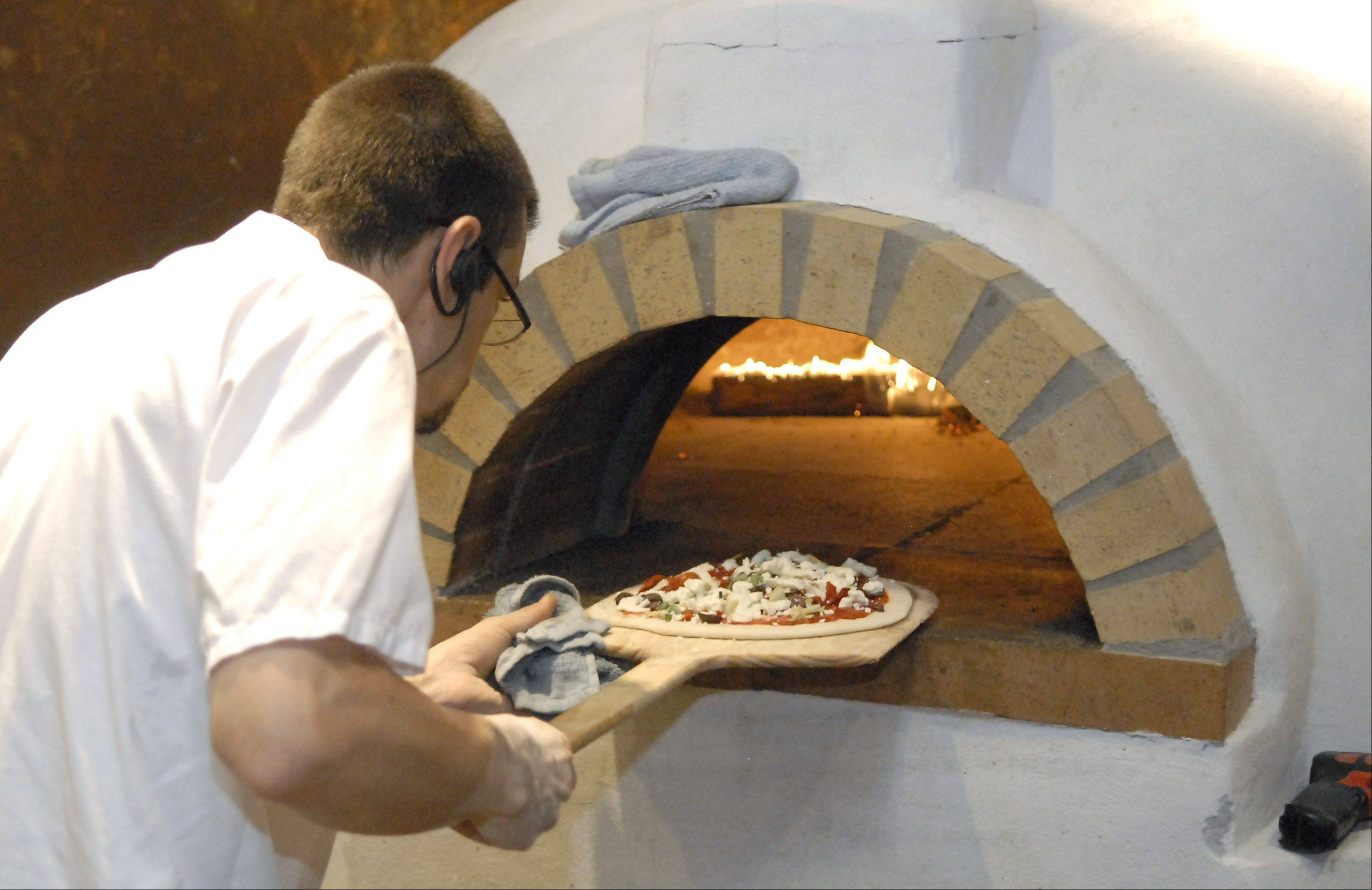 Pizzas are made in a wood burning oven at the Village Vitner in Algonquin.